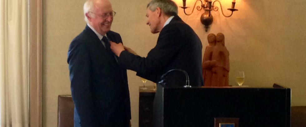 Director John English receives Order of Merit from German Consul General Walter Stechel