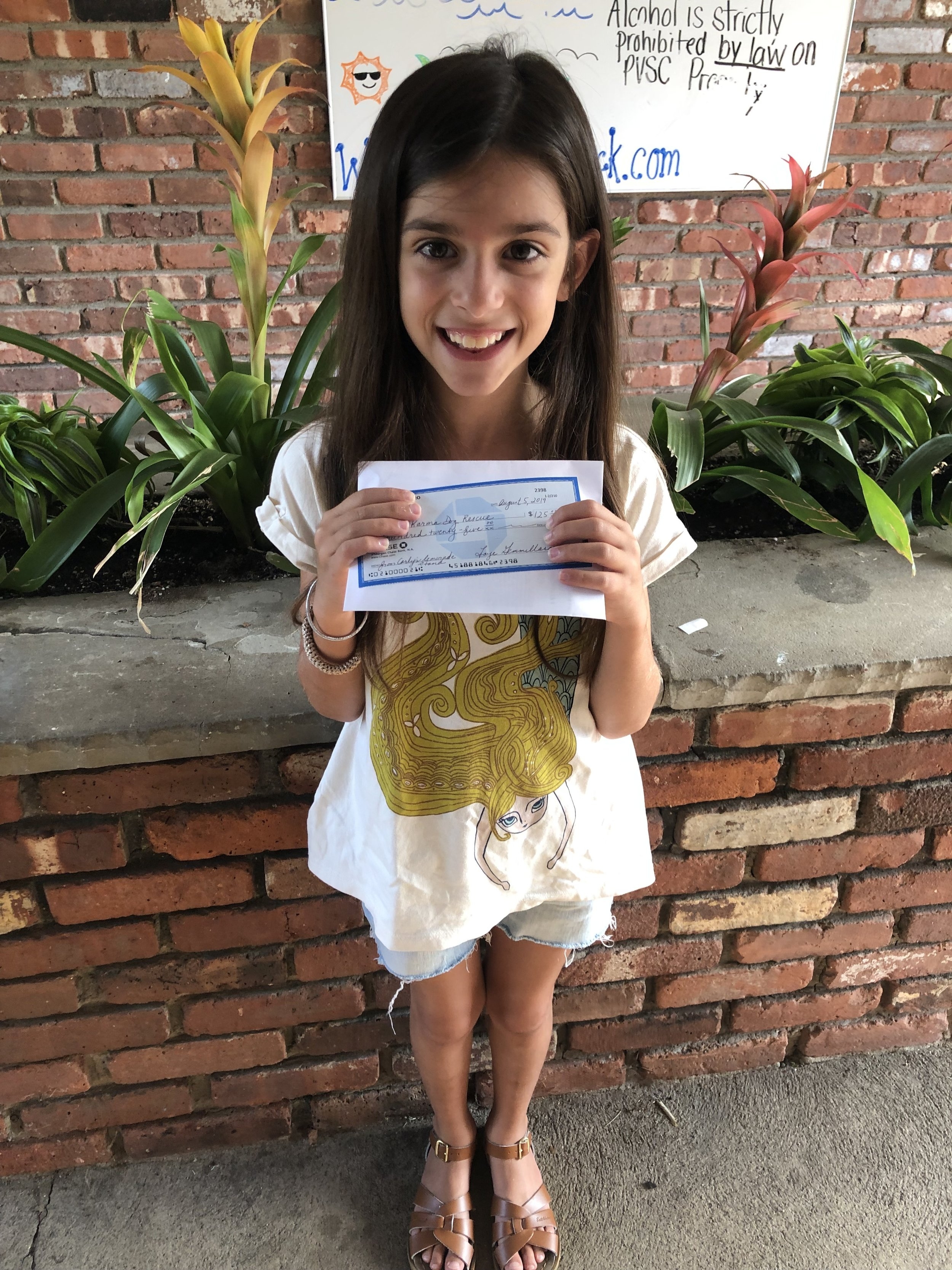 THANK YOU to Girl Scout, Carly, who held a lemonade stand at her home for the pups of Good Karma and raised over $100! We are so proud of you and are so grateful for your help!