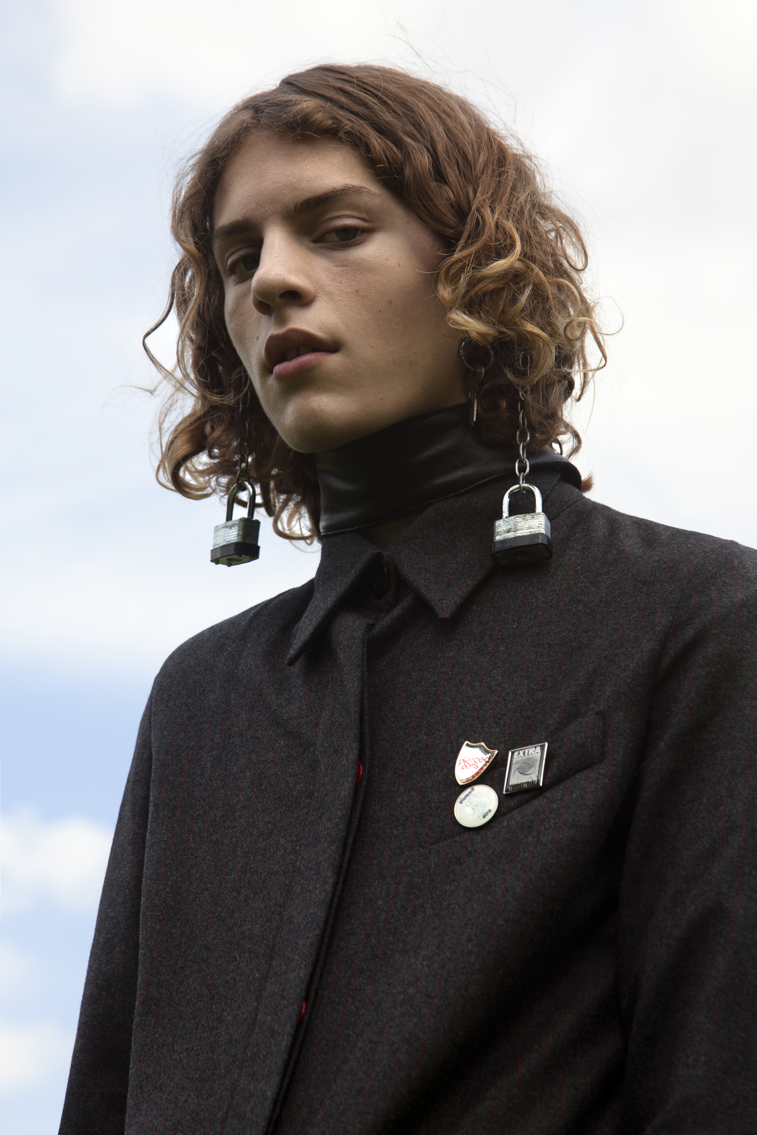 Zach Norton  wearing coat by  Ashley Williams , belt used as choker by  Toga.