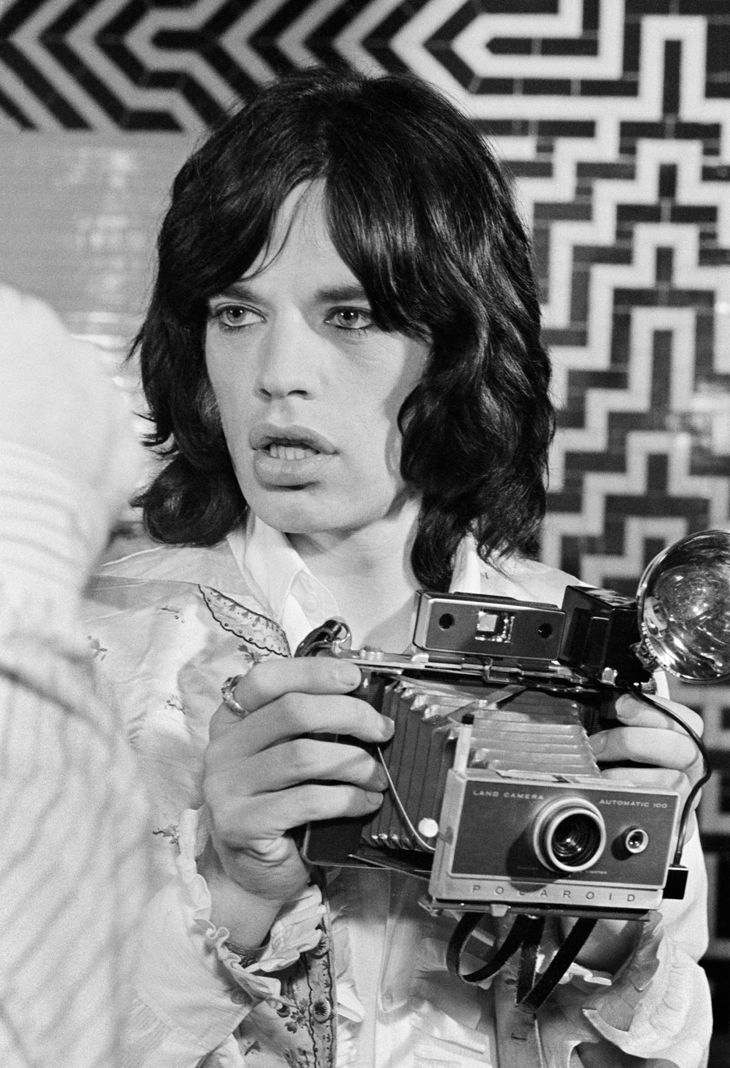 "Mick Jagger on the set of the film ""Performance,"" London 1968  Photo ©Baron Wolman / Iconic Images"