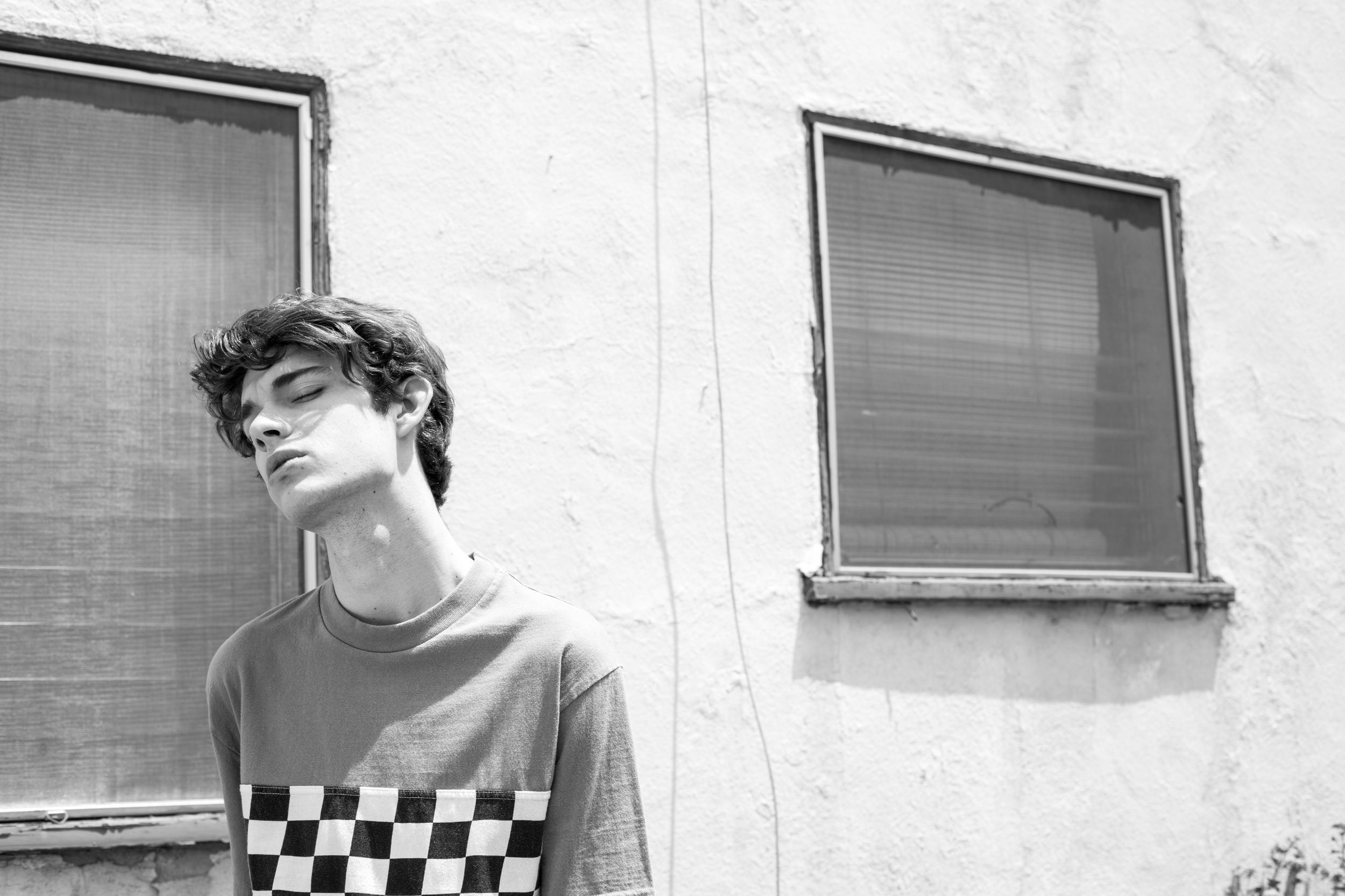 Jack wears checkered tee by  CPO .