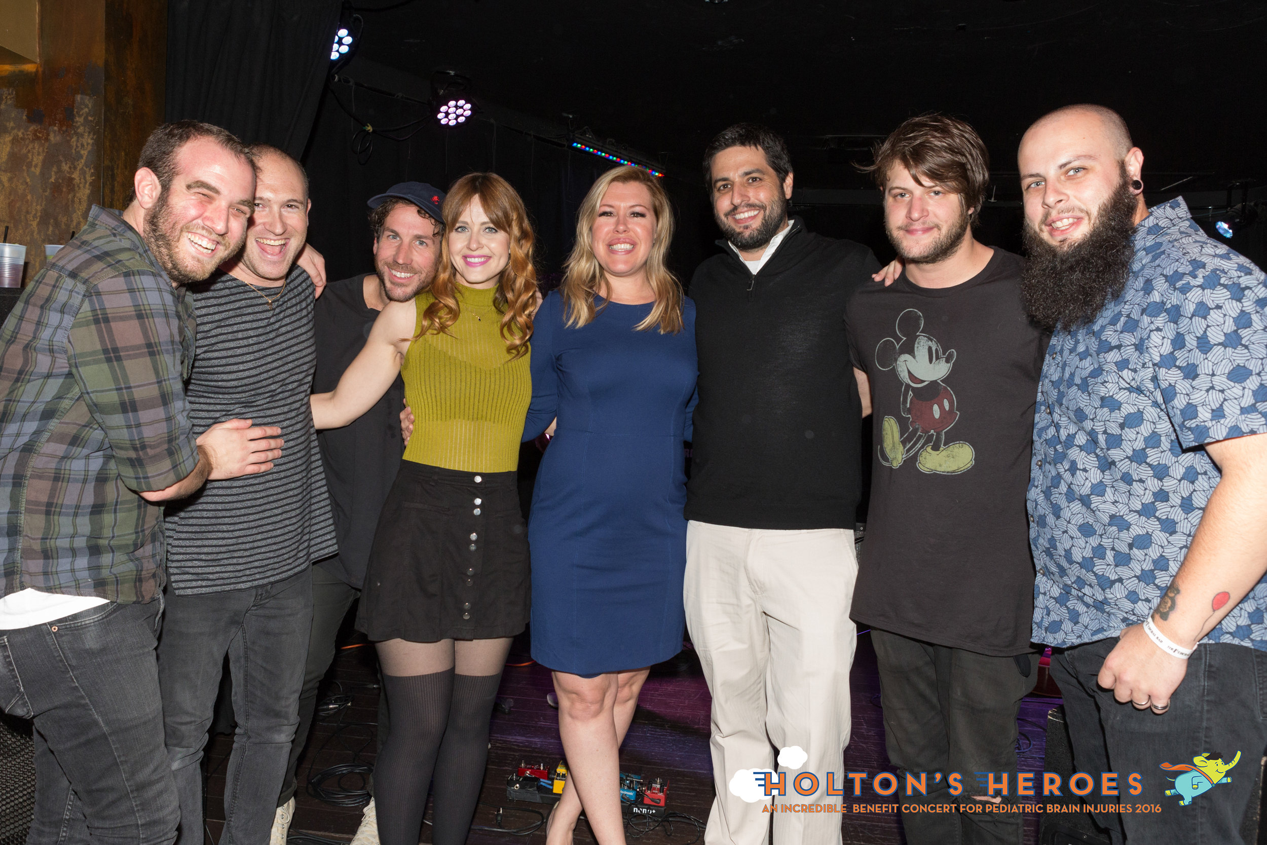 Angela and Eric (middile) post with the Mowgli's.   Photo by Chyna Photography
