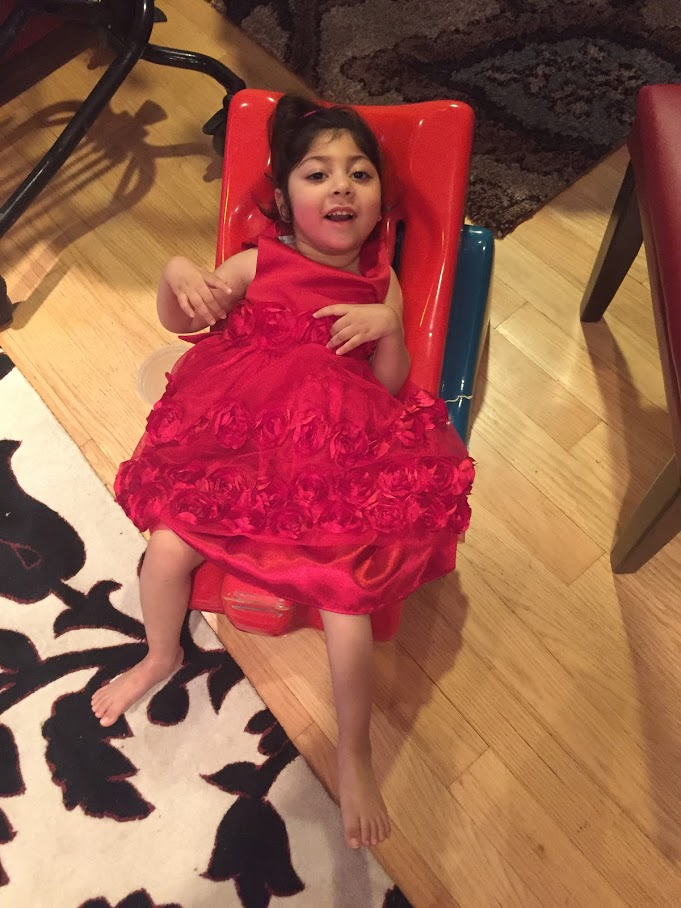 Aleena in a Tumbleforms chair