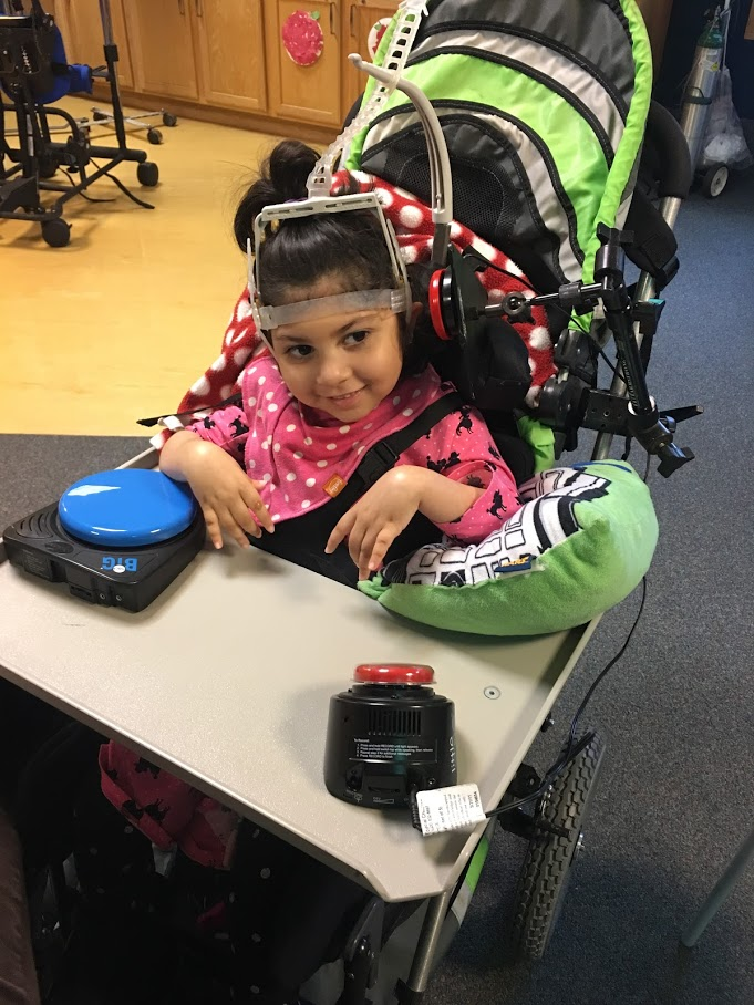 Aleena working with communication switches at therapy.