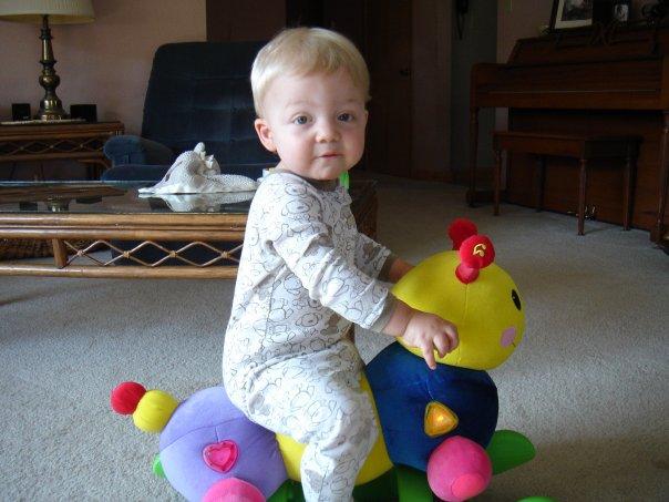 Owen as a toddler on his favorite catepillar