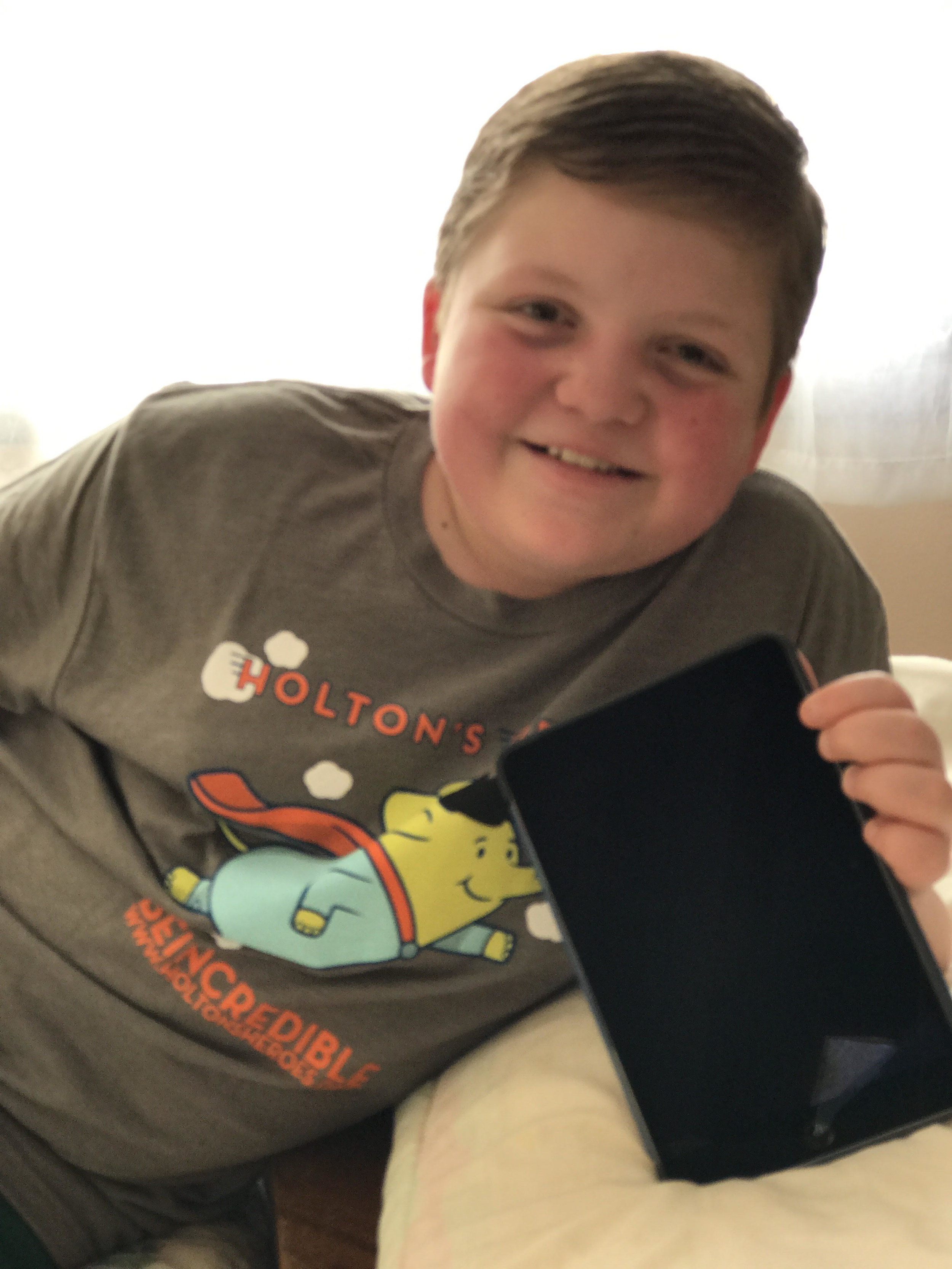 Owen rocking his HH shirt while displaying his new iPad mini for therapy