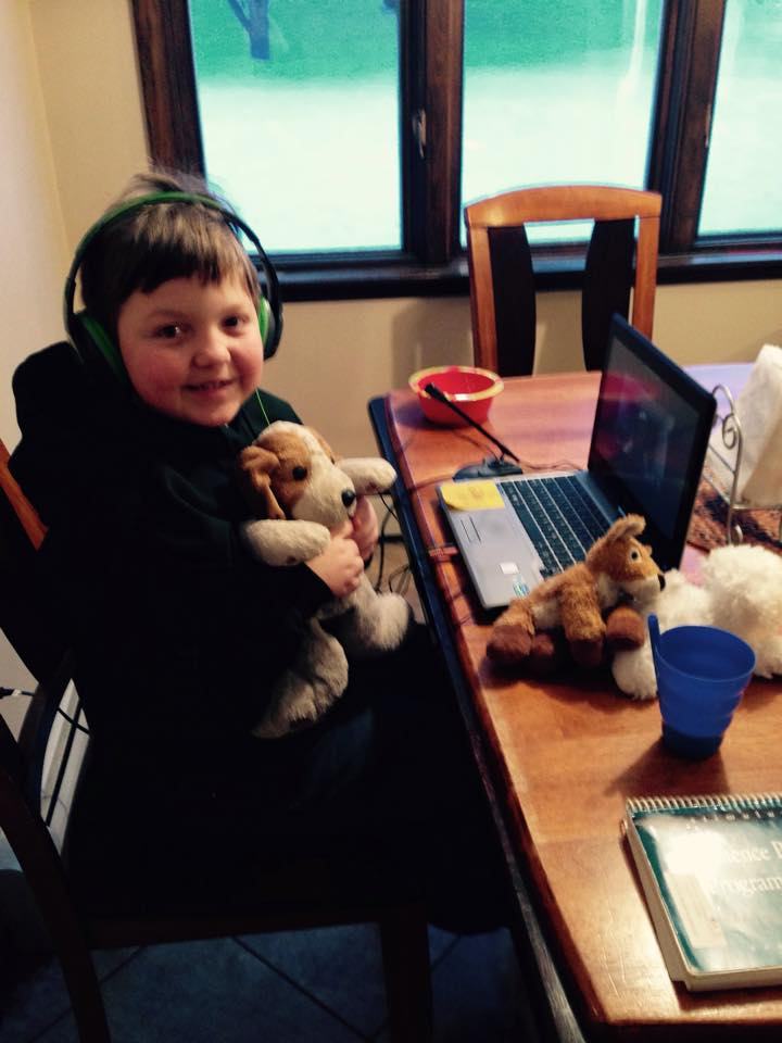 Owen participating in a teletherapy session to help with speech and language