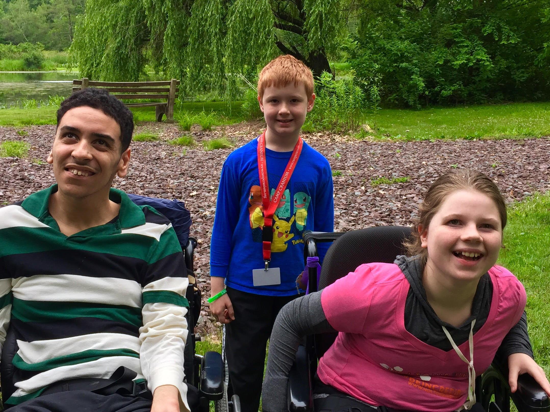 Luis, Bryan, and Ava together at Camp Cranium