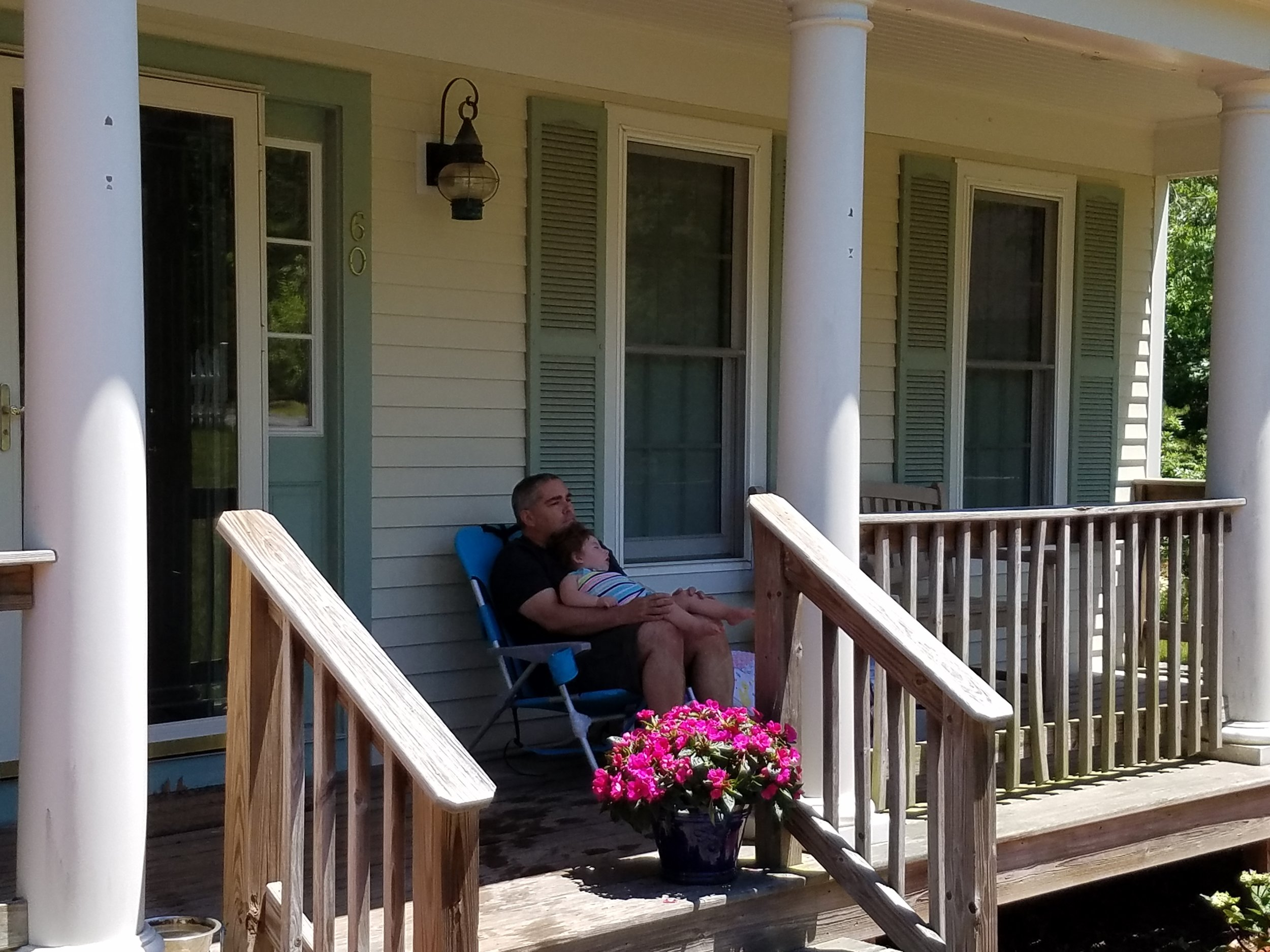 Leila and her dad relax on porch