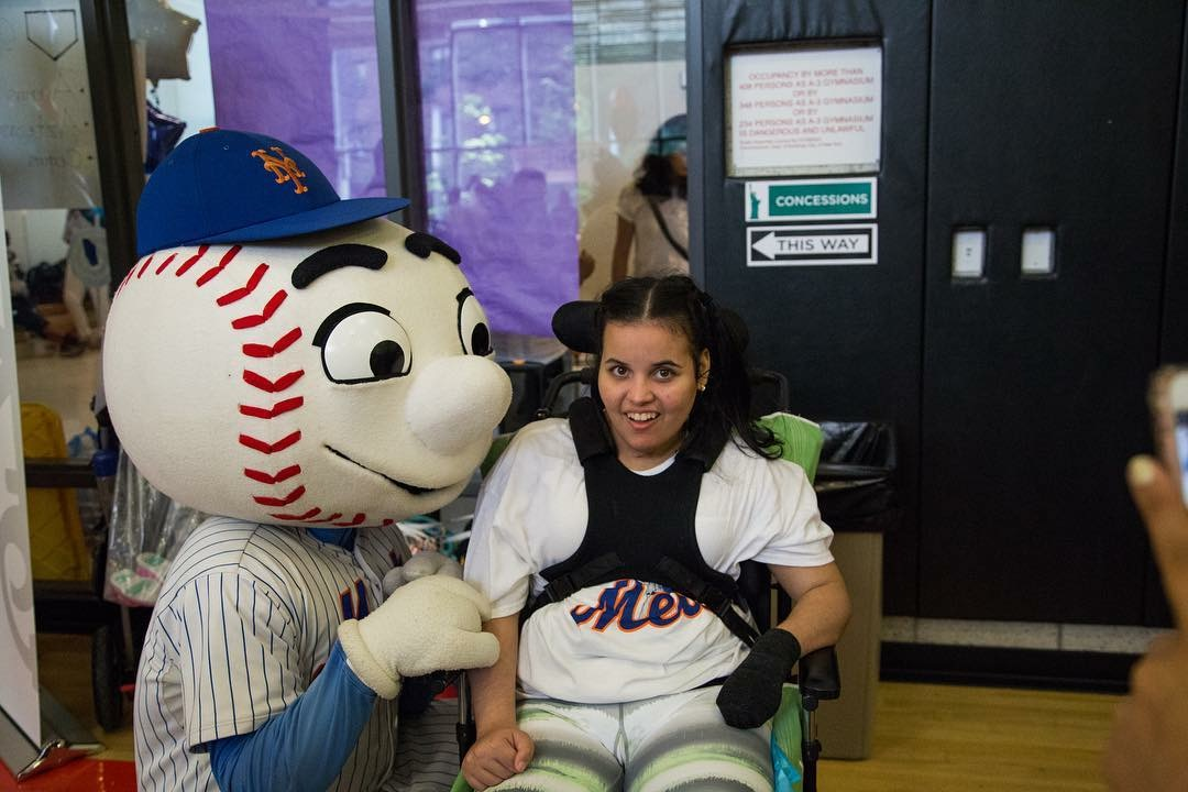 Maria hanging out with Mr. Met!