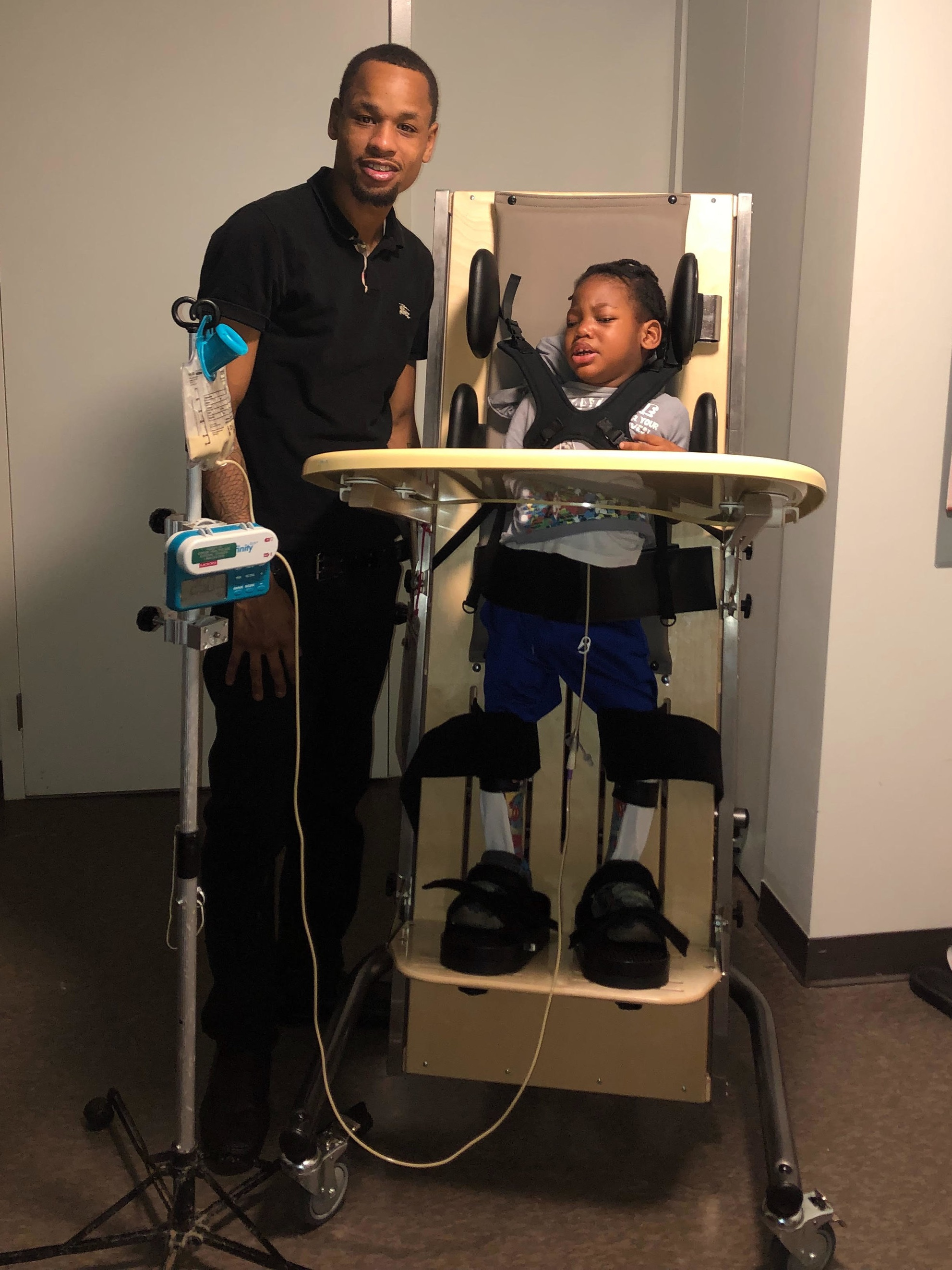 Tyree with his son Zahir in his new standing frame from Holton's Heroes