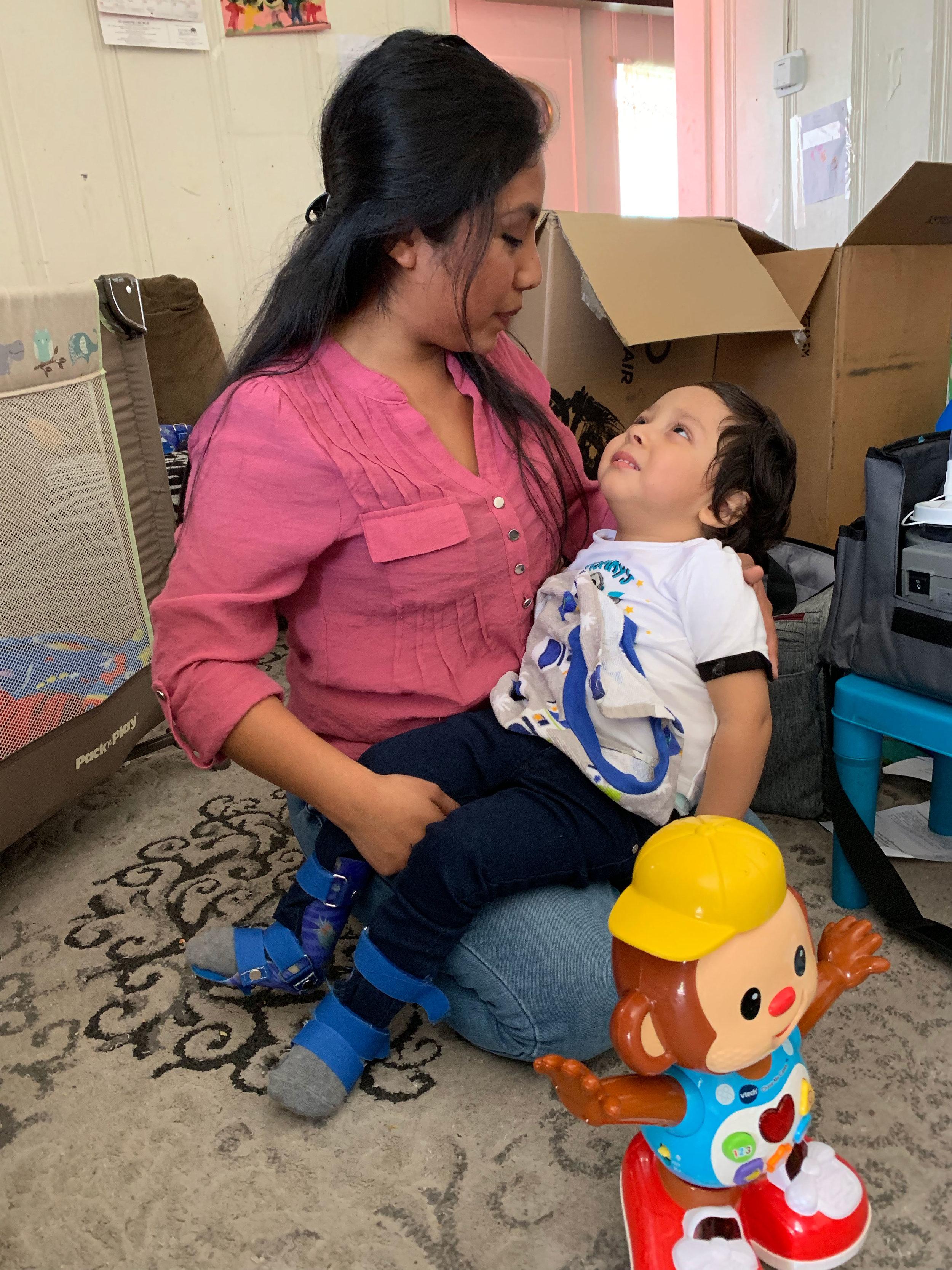 Ana holds her son Matthew.