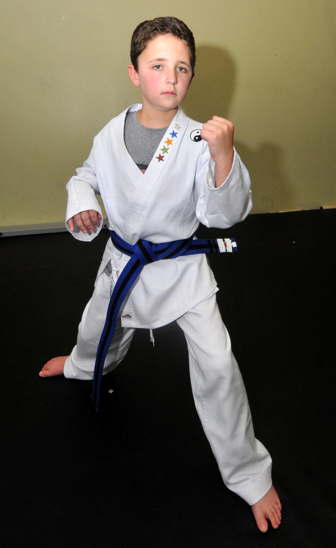 Chase strikes an intimidating karate pose post-stroke.  Photograph by Carl Kosola