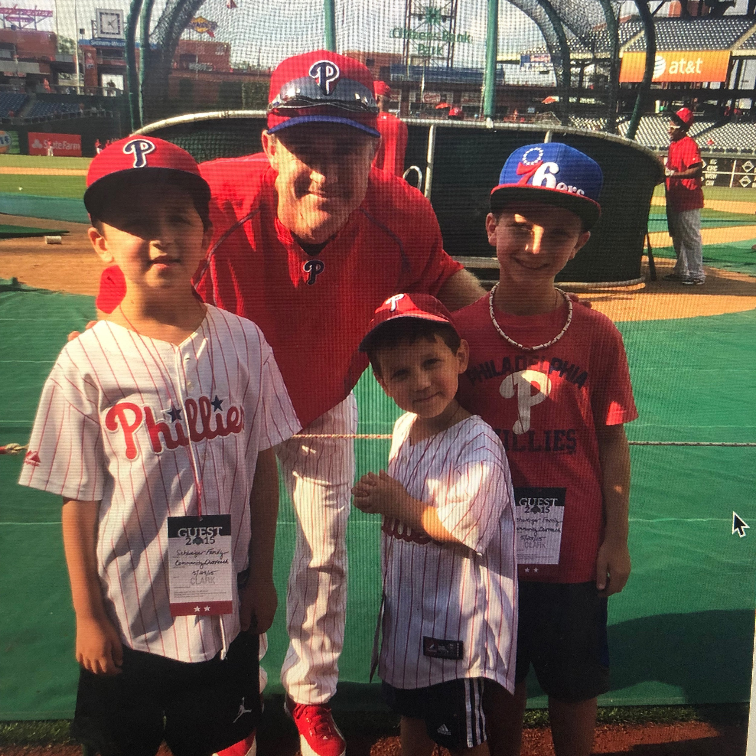 Chase, Sam, and Chase's younger brother Mason pose for a photo with Philadelphia Phillies great Chase Utley.