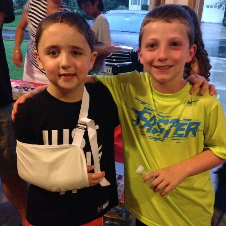 Chase and his best friend Sam pose together shortly after discharge. Sam had shaved his head in solidarity with Chase.