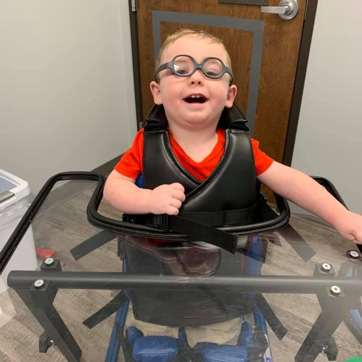 Colton standing tall in his stander.