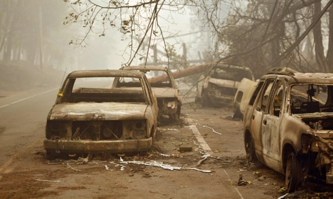 Burnt-out vehicles are seen on the side of the road in Paradise, California  Photograph: Josh Edelson/AFP/Getty Images  PHOTO CREDIT: https://www.theguardian.com/world/gallery/2018/nov/12/california-wildfires-trail-of-destruction-in-pictures