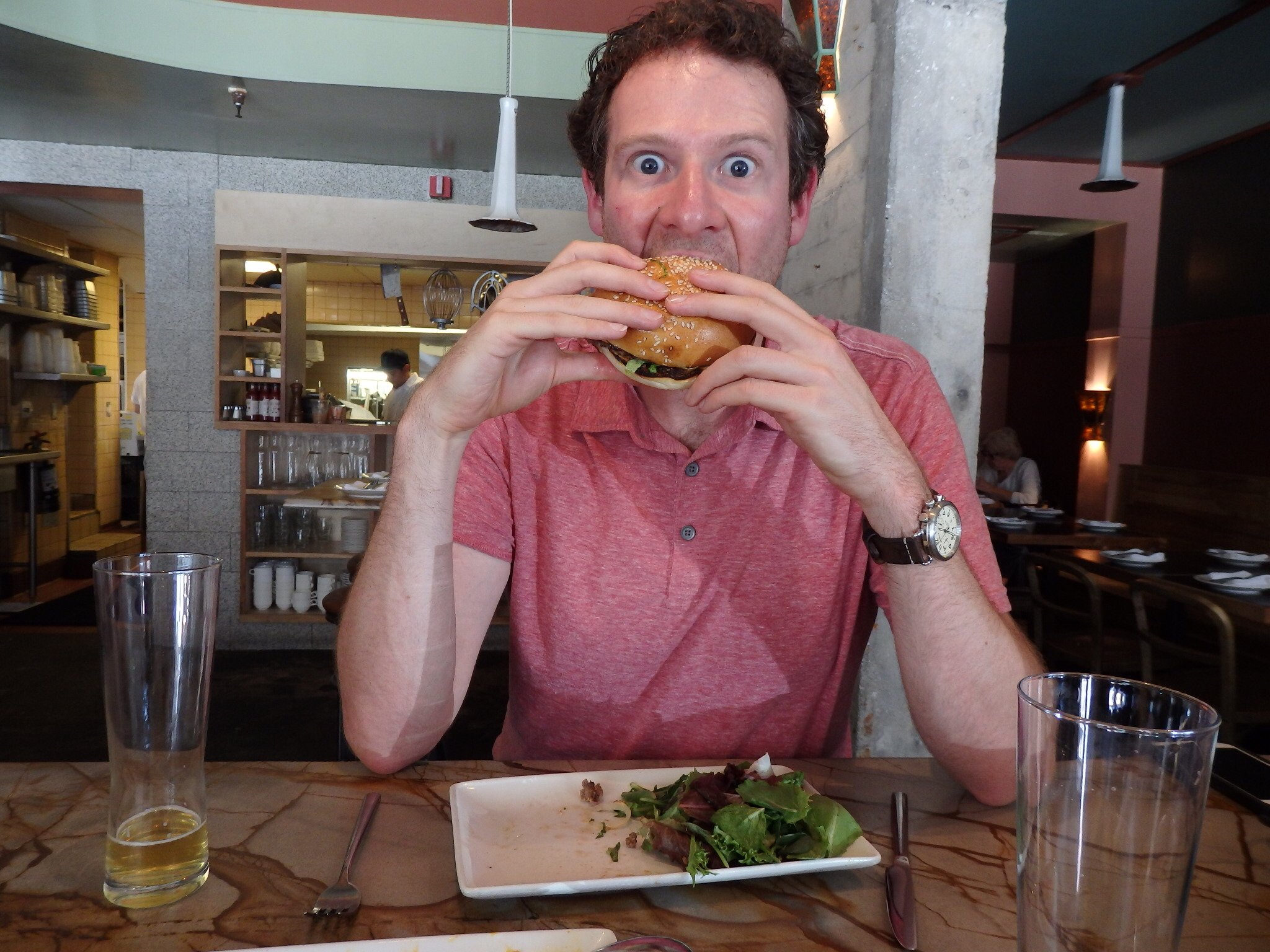 Olly gets his mouth around an Americana - just as Kevin insists. No cutlery!