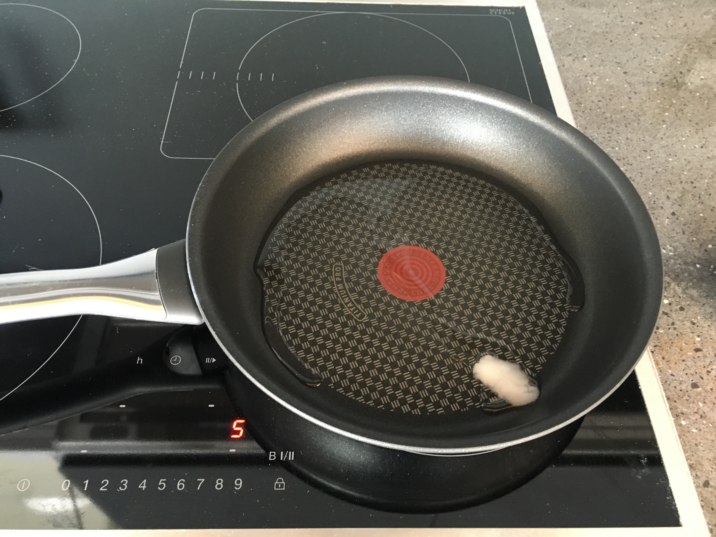 Step 1: Begin heating pan and coconut oil on medium heat