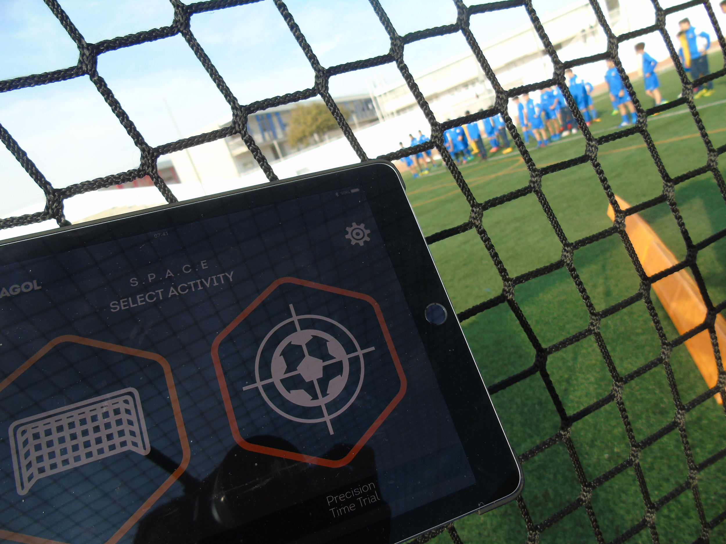 """Proprietary Tech Software - The Hexagol Tech Pack offers a revolutionary way to enjoy football. By combining traditional drills with cutting edge technology players can test and track improvements in ball-control, passing, shooting, reactions and stamina.Within the """"Cell', the Tech Pack consists of 12 LED illuminated targets; 6 net mounted and 6 corner mounted kick-boards. These connect wirelessly to the Hexagol S.P.A.C.E.S iOS app via the bluetooth 4.0 Basestation. The simple and intuitive S.P.A.C.E.S app contains a number of games designed specifically to hone and improve certain player attributes."""