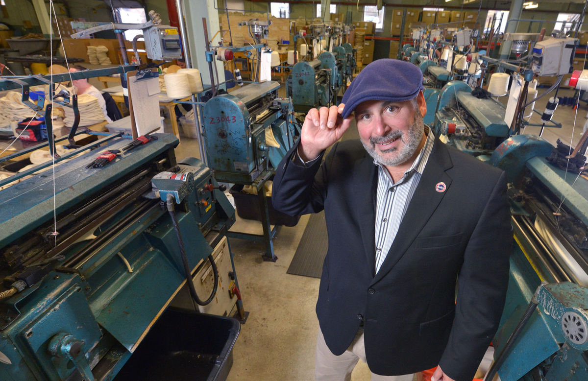 Bollman Hat Co. CEO Don Rongione posing with the newly acquired sewing machines. Photo by Richard Hertzler, Bollman staff photographer.