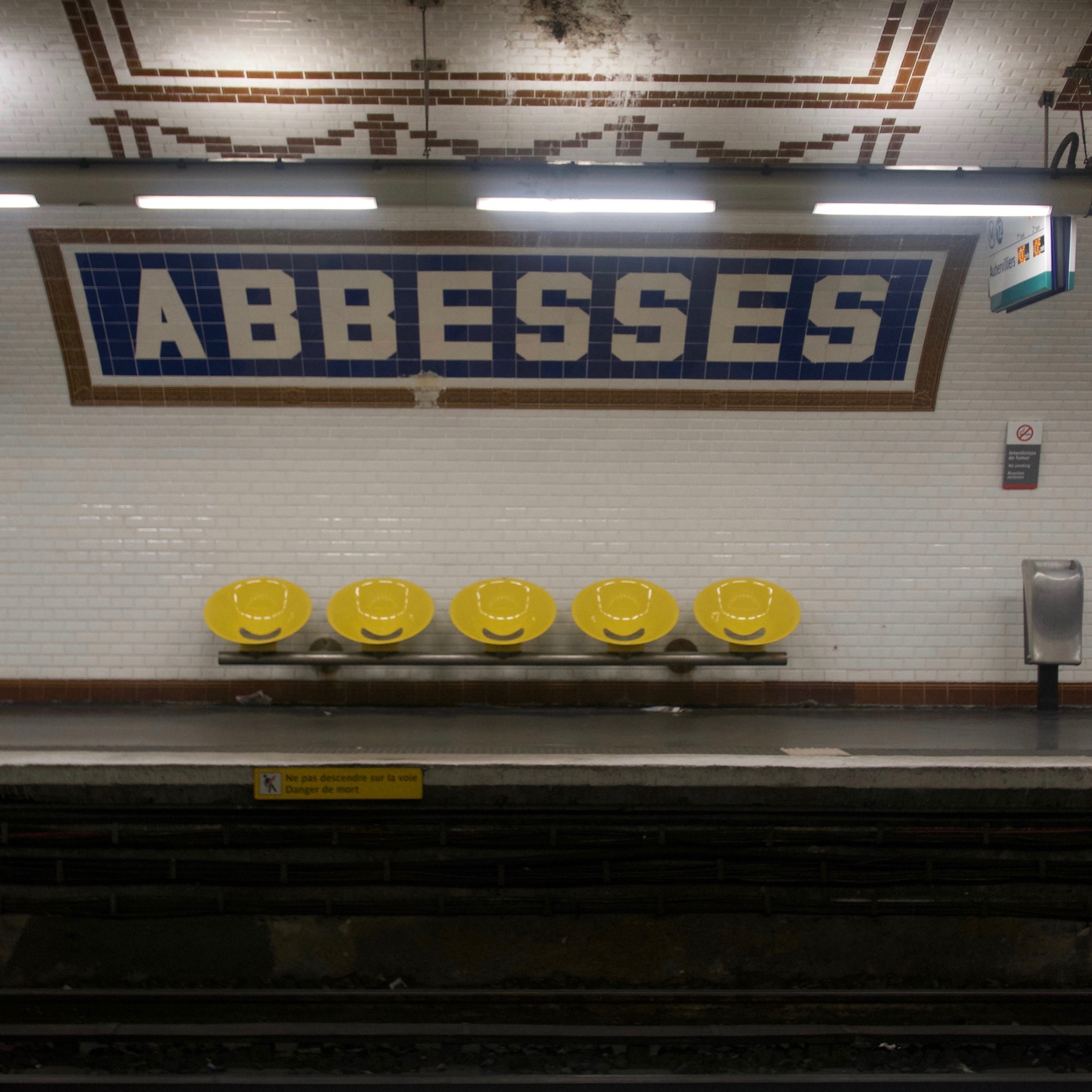 The Paris Metro stations have such cool designs, I LOVE the yellow smiley face chairs.