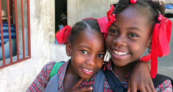 Our volunteers help our partner organizations grow and help their own constituents - like these schoolgirls in Haiti! Photo provided by Dr. Deborah Ottenheimer.