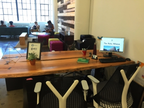 Kota's desk at the  Centre for Social Innovation , with some partner organization members working in the background.