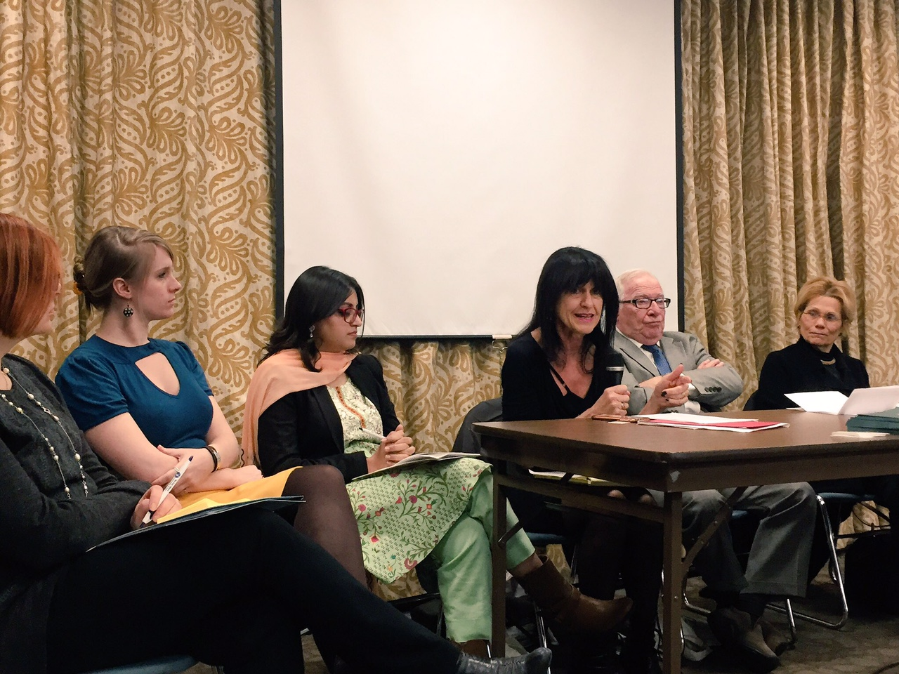 Sari Gold, Christen Brandt, Gulalai Ismail listening to Susan Blaustein, with Irving Fish and Louise Guido.