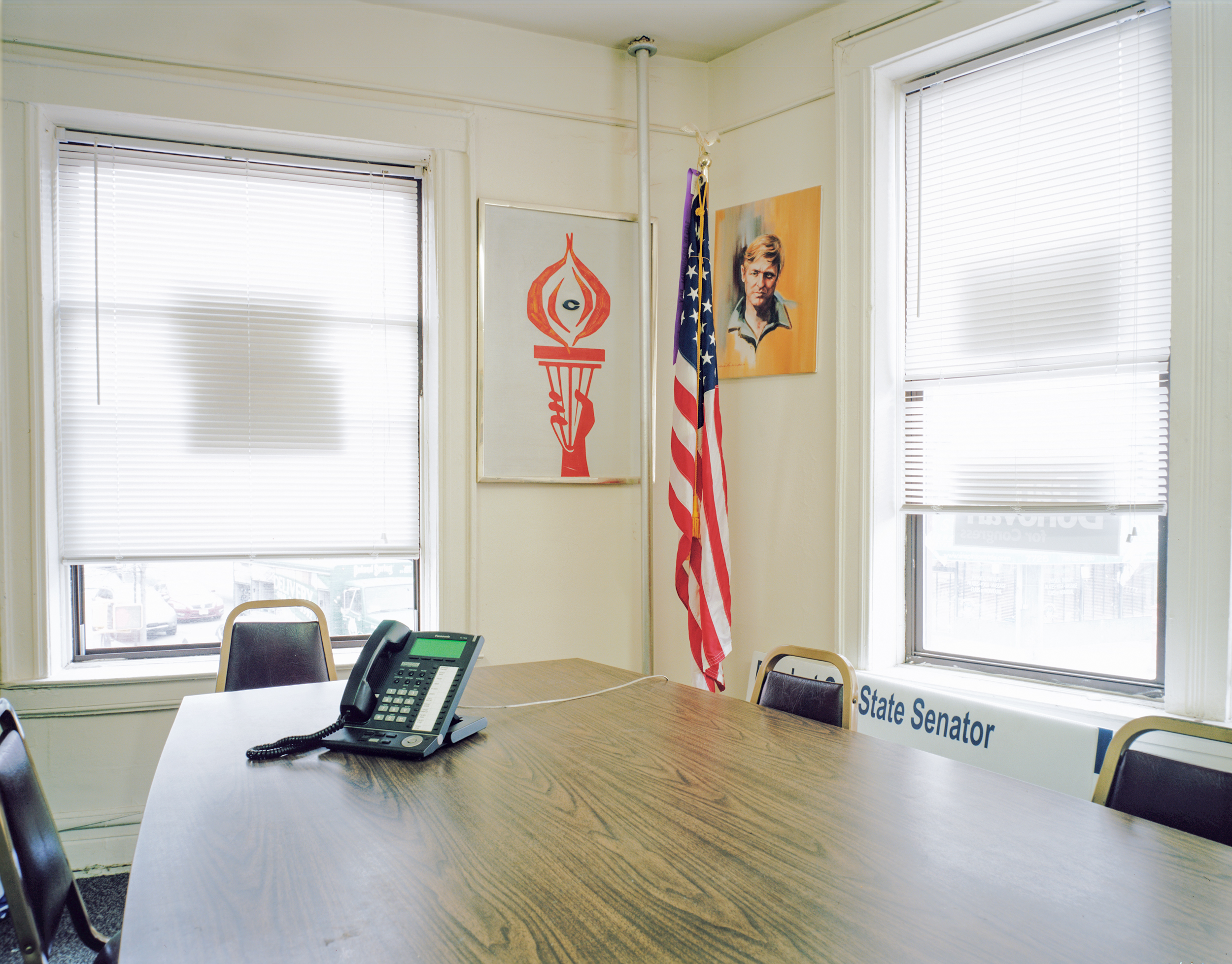 The meeting room of the Conservative Party of New York State. Visible through the windows are storefronts of the rapidly changing Bay Ridge neighborhood in which it is located.