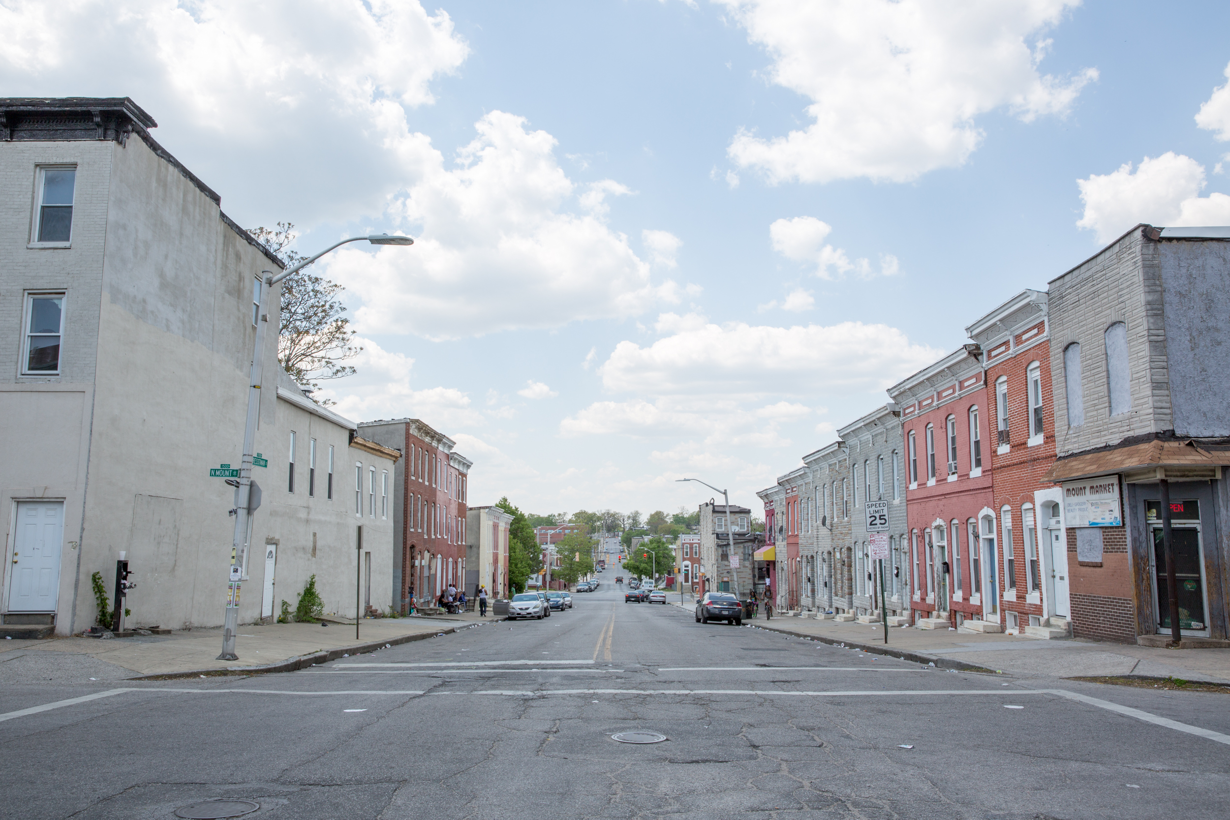The intersection of N Mount and Presstman streets, an archetypically Baltimore row of houses.