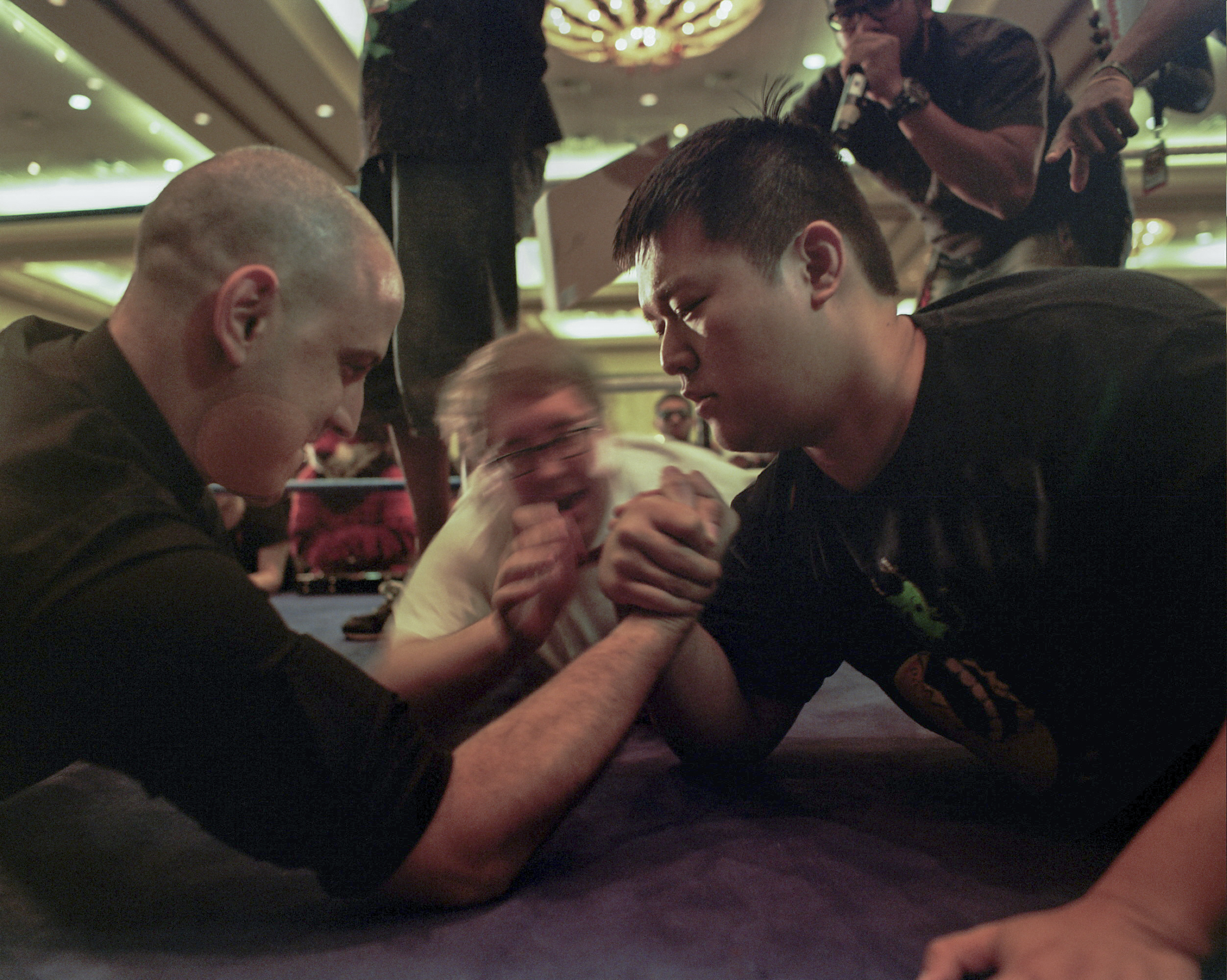 "Alex ""Jebailey"" Jebailey, organizer of the CEO competitive gaming tournament, and Mark ""MarkMan23"" Julio, community manager for MadCatz  arm wrestle during a tournament to kill time."