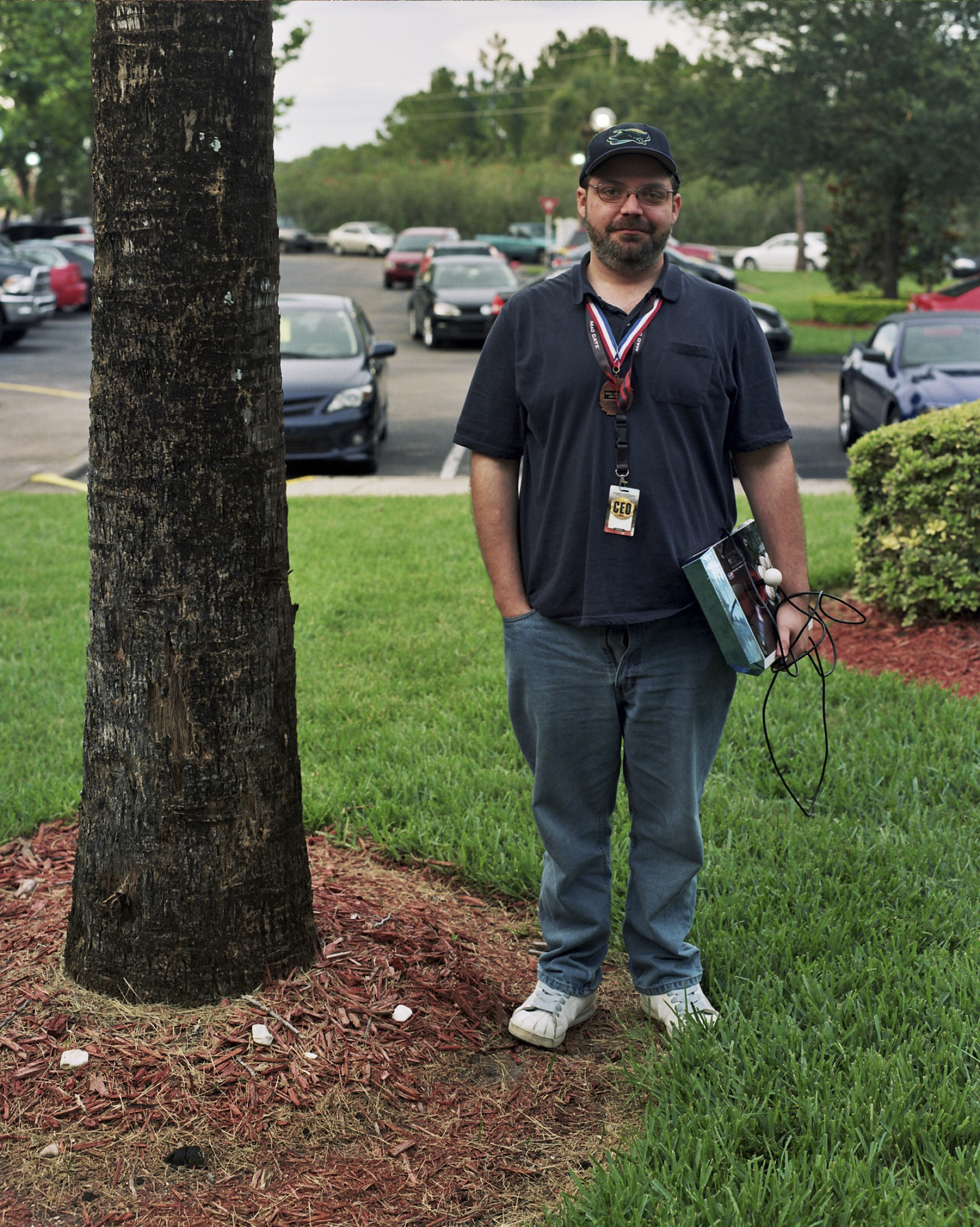 A Soul Calibur player poses for a picture in the early morning by a palm tree in Orlando, Florida.