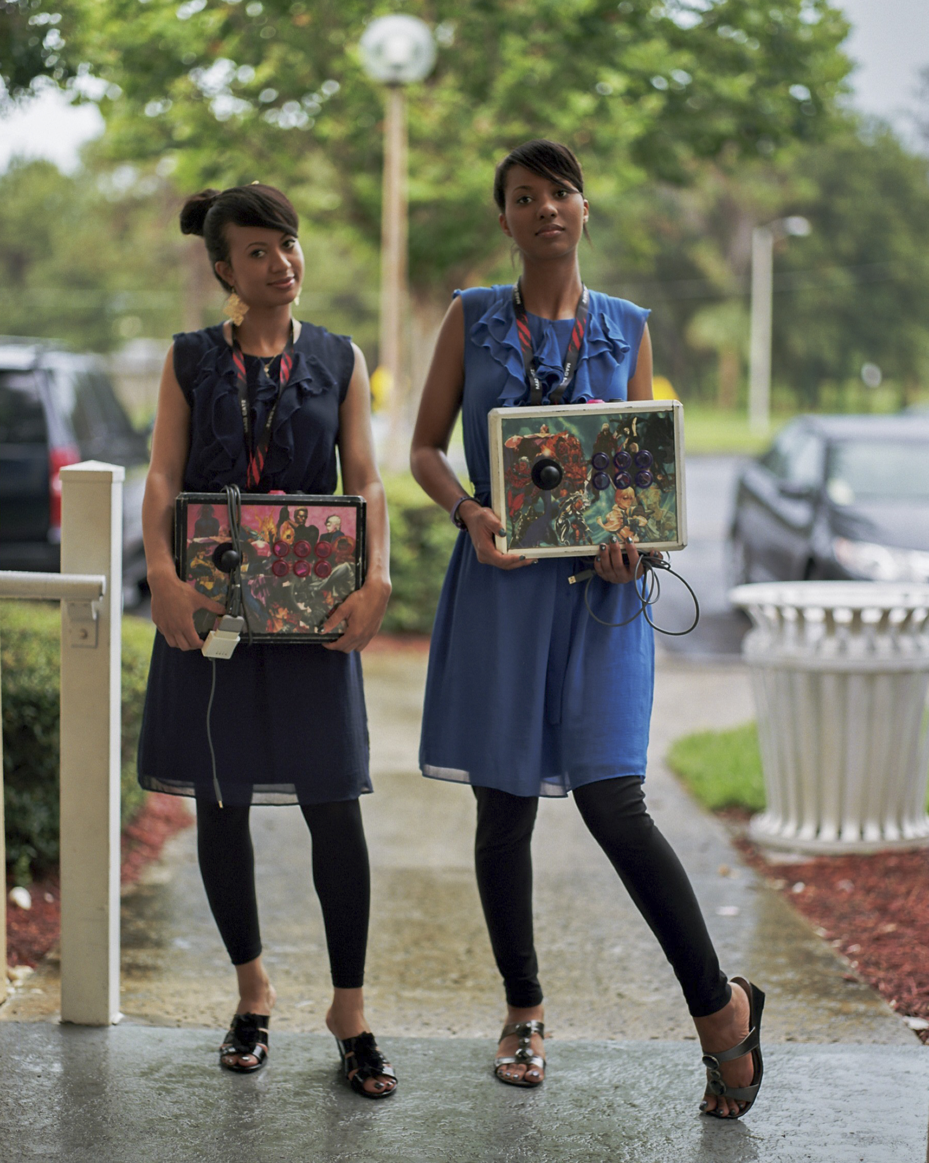 "Lina Crawford and Etta ""Abare Ky"" Crawford with their custom-made arcade sticks. Originally from Hawaii but currently residing in Arizona, the twin sisters have been longtime competitors in fighting games."