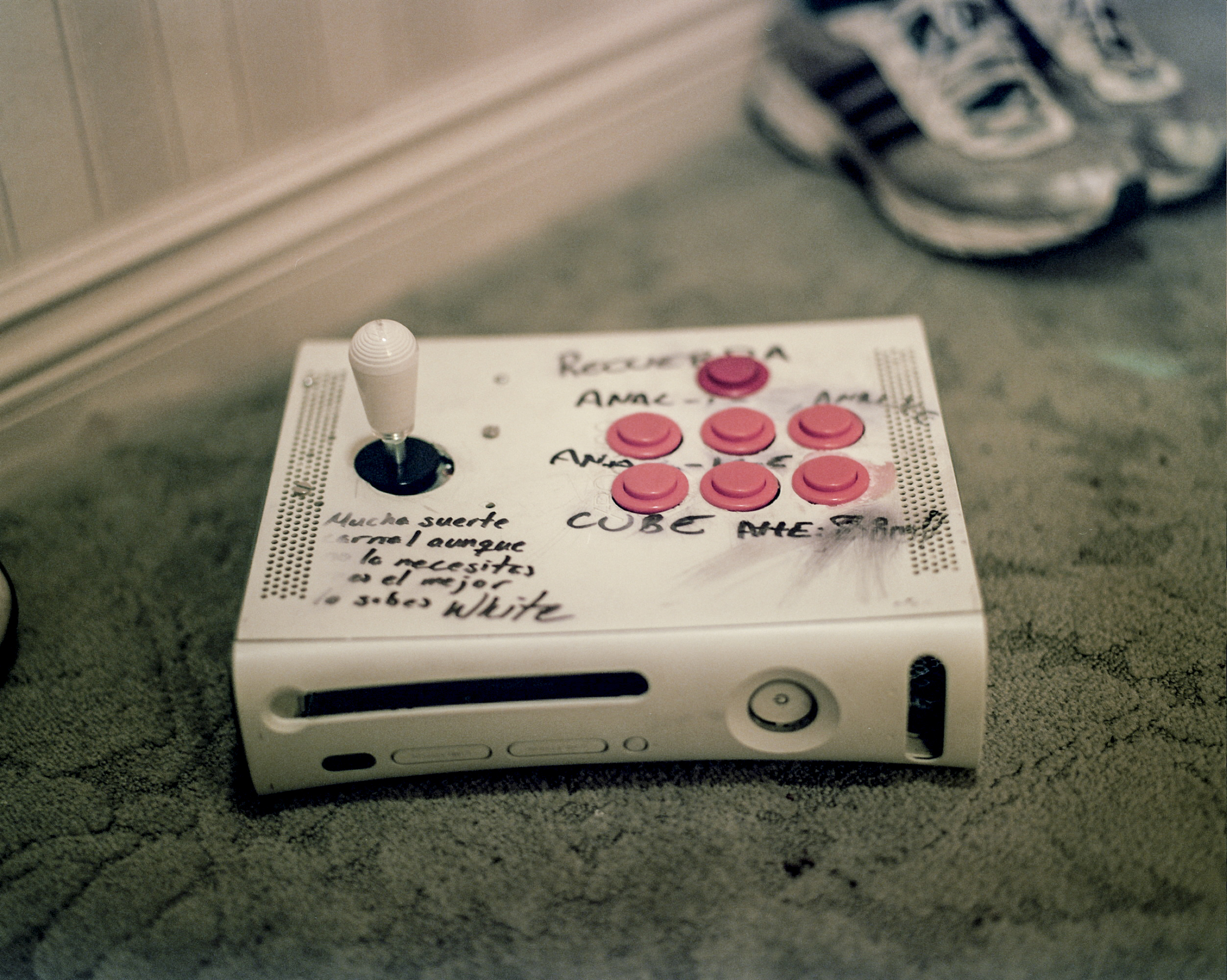 "Cesar ""TA Frutsy"" Garcia's, 27, home-made arcade stick sits on a hotel room floor at the Paris Hotel in Las Vegas, Nevada at the EVO competive gaming tournament. Cesar, a noteworthy Mexican player, came to prominence for his unorthodox playstyle and home-made arcade sticks. This stick is made out of an old X-Box 360."