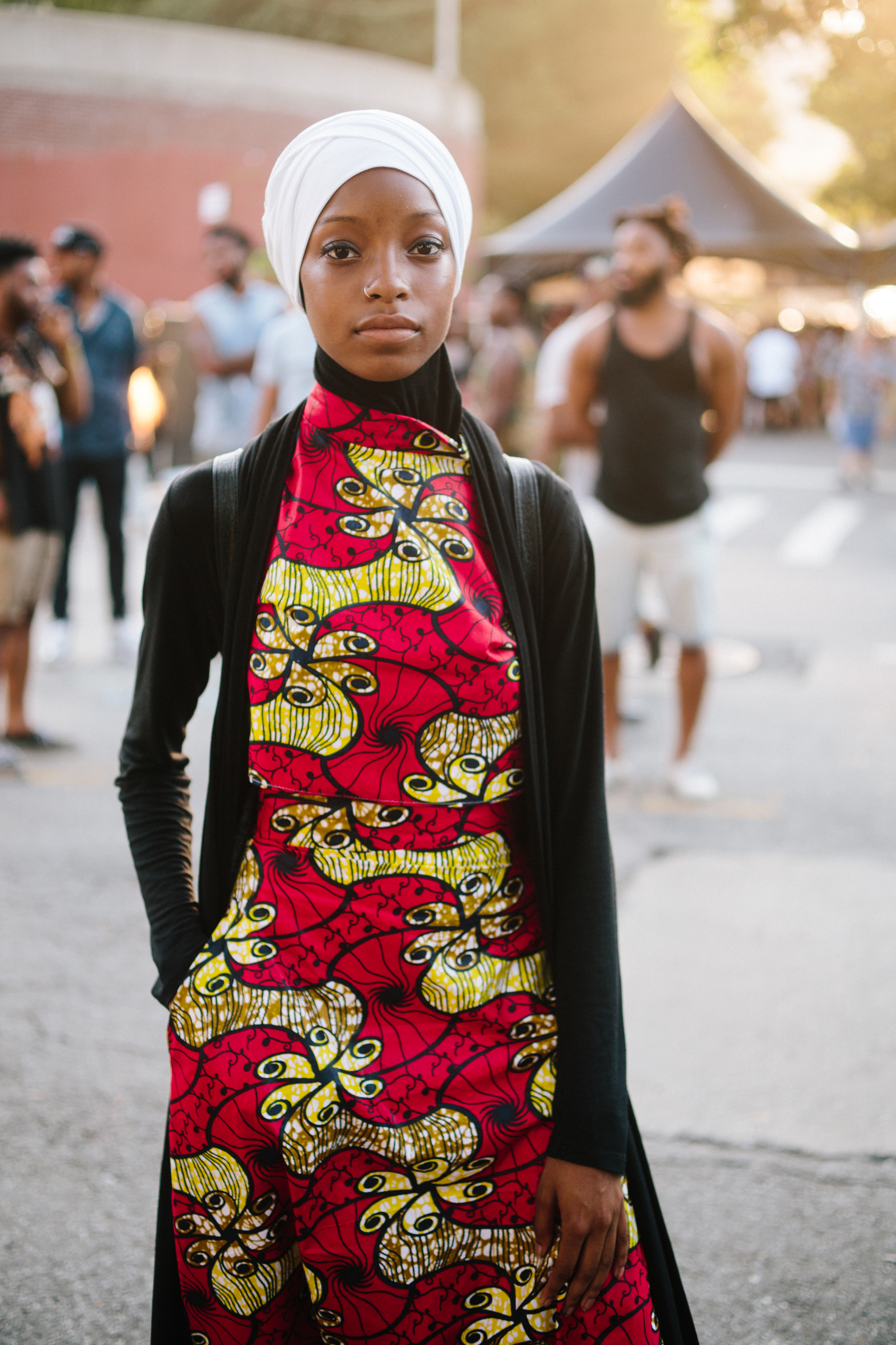 "Sumayah, 19. ""I don't see harem pants as much anymore, so I go for it cause it's different... My mom made my clothes... The African tribal print... We're west Indian and my grandmother is from Barbados, so those are my influences."""