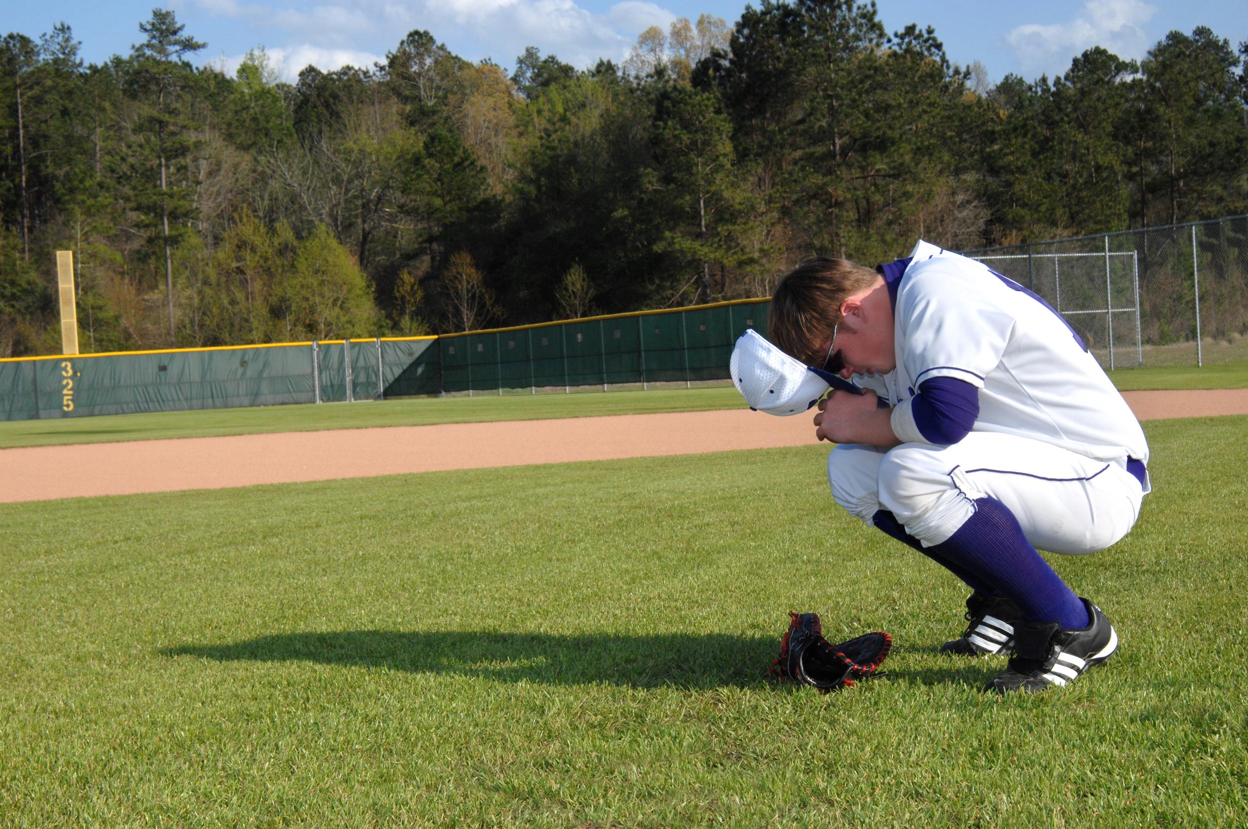 praying baseball player