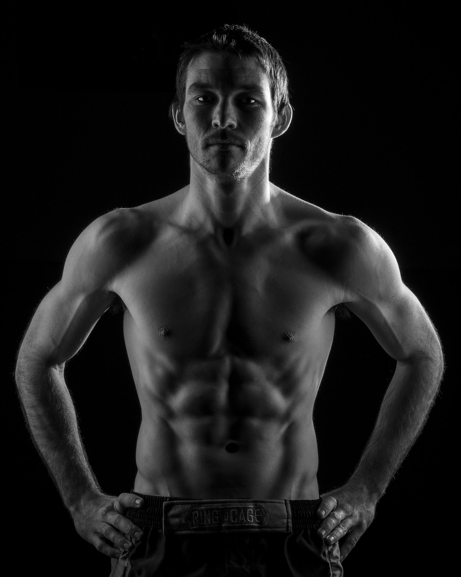 Promo style picture for Jessie, hard side light to accentuate his physique.
