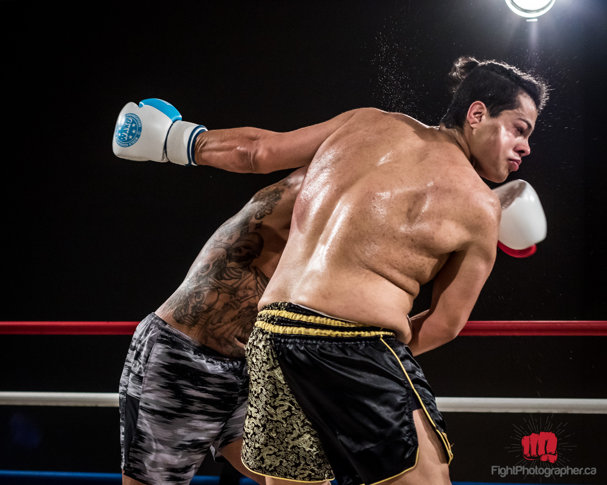 heavyweight-kickboxer-takes-punch.jpg