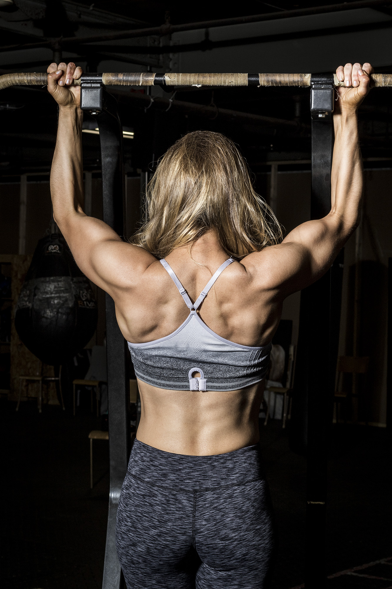 Showing off shoulders, arms and back on a pull up.