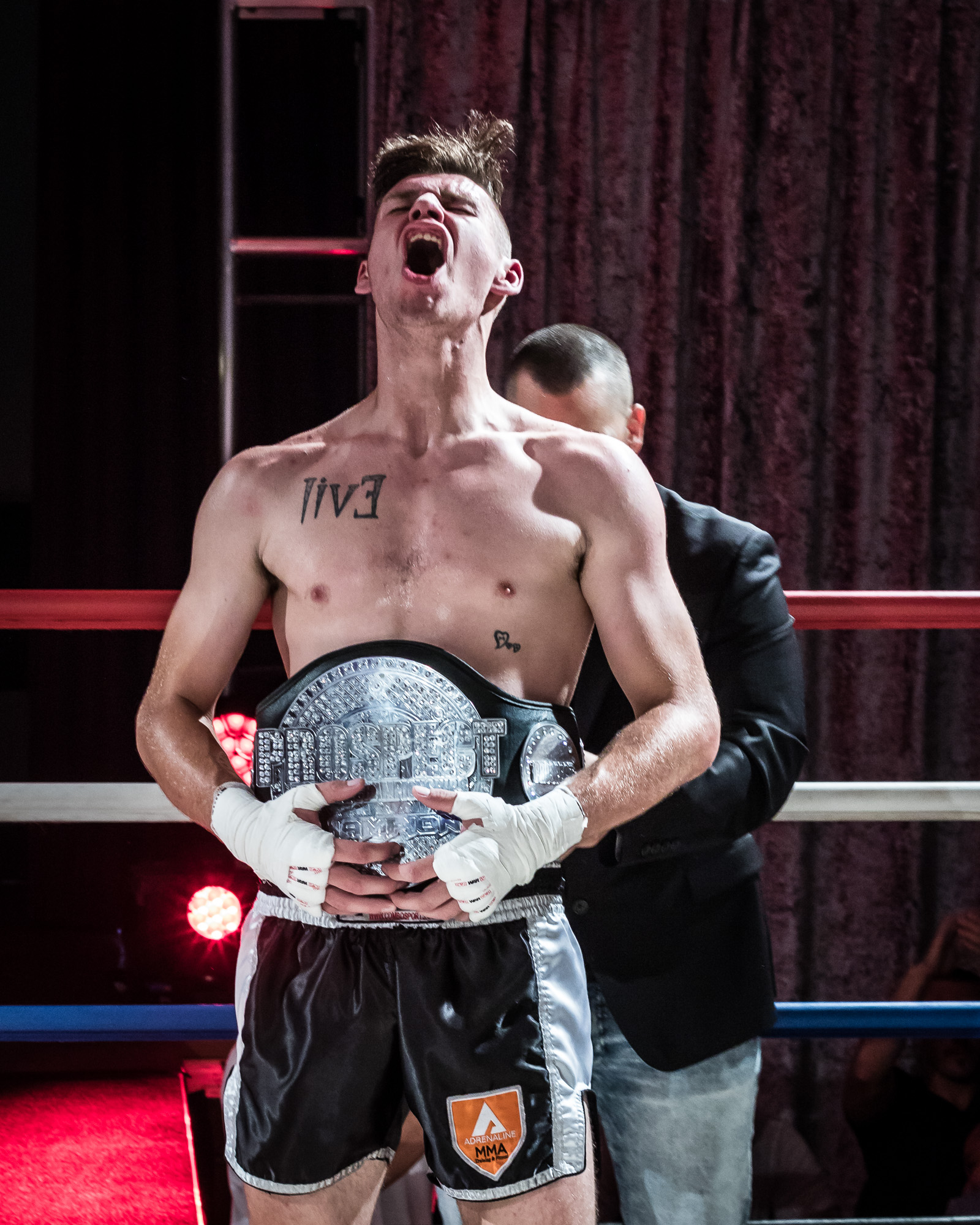 Gord Cunningham winning the light heavyweight title.