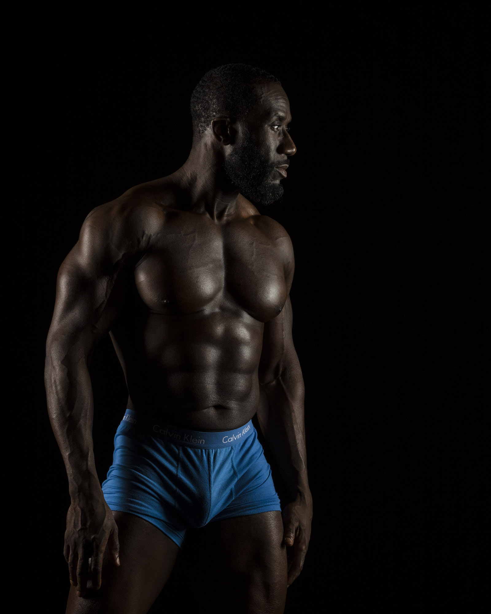 Using the lights to highlight his physique