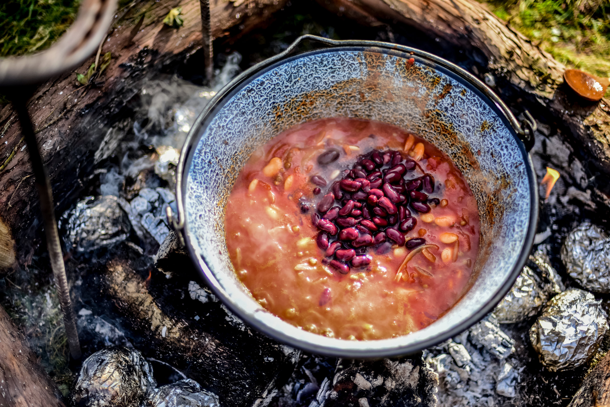 Go Wild Forest School Level 3 Training campfire cooking beans.jpg