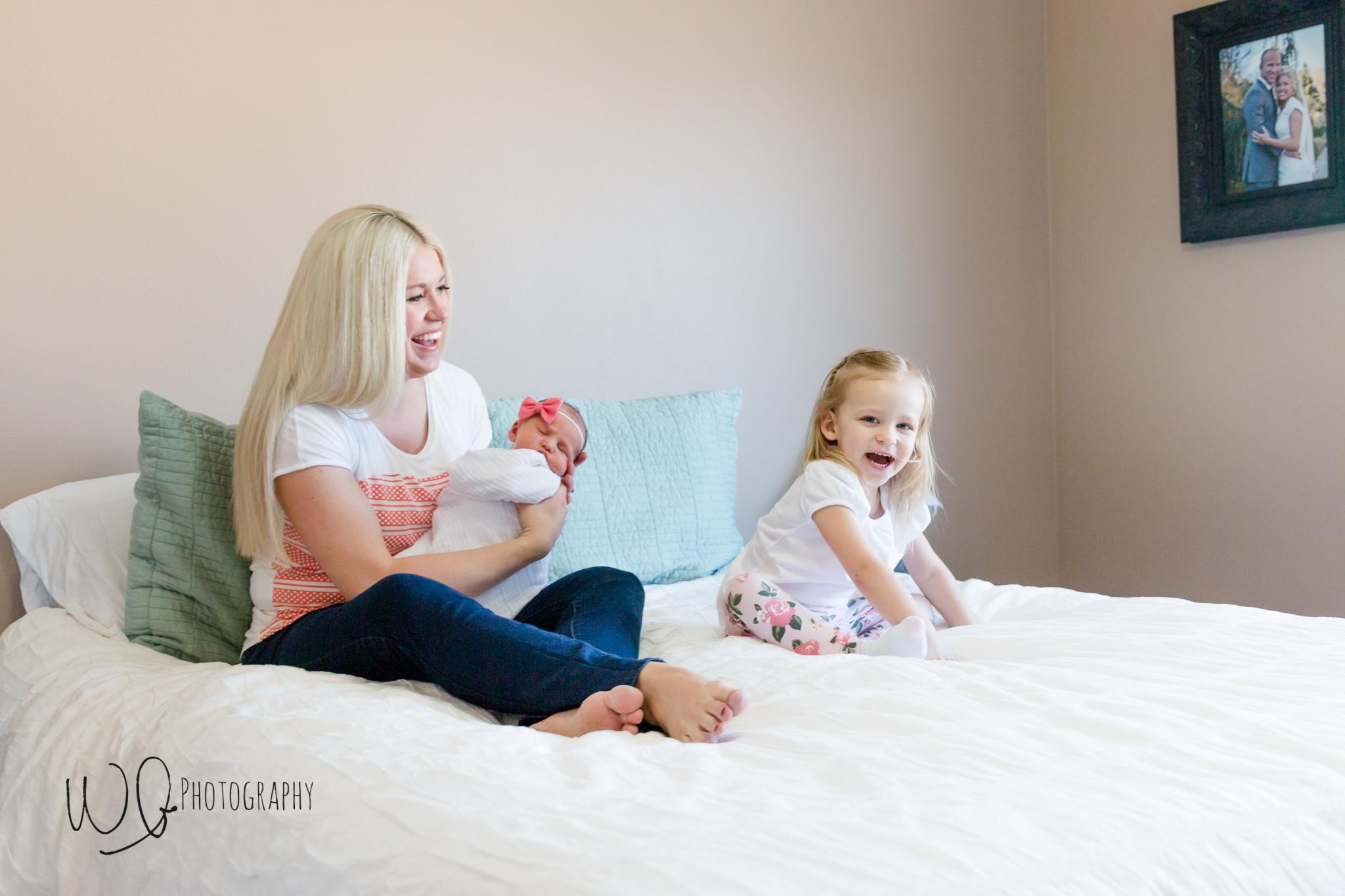Lifestyle newborns vs posed newborn photos