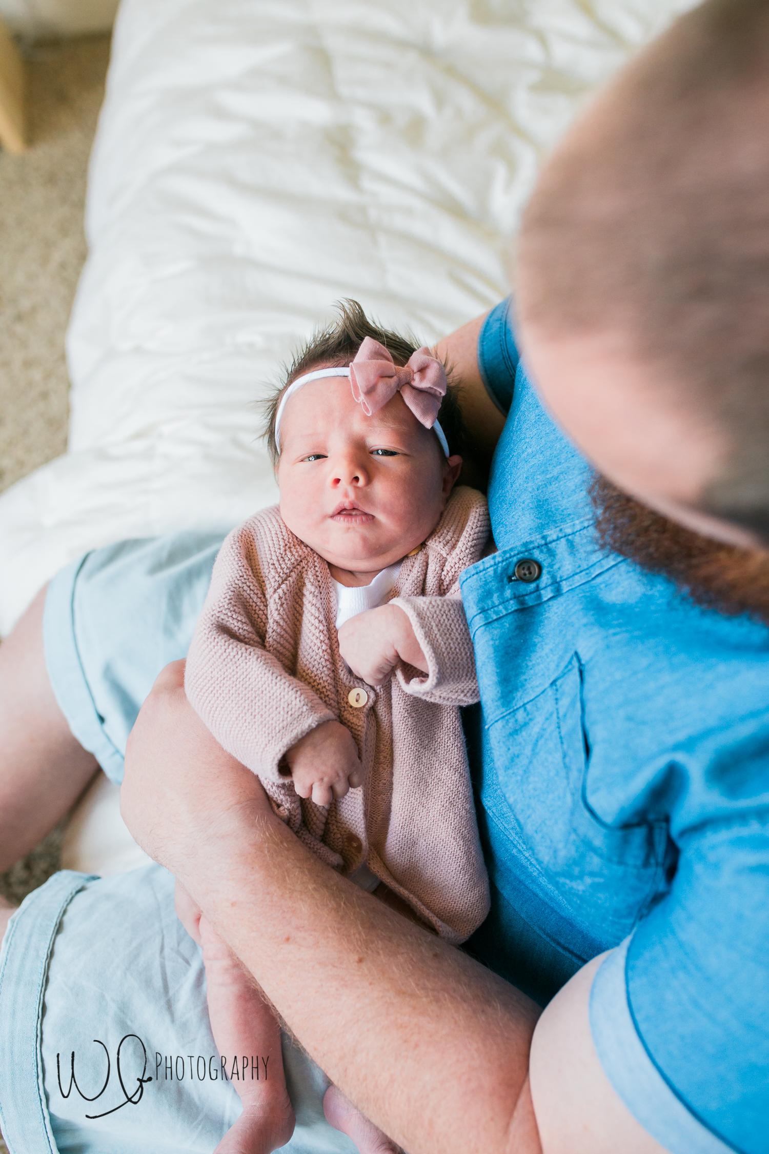dad holding newborn