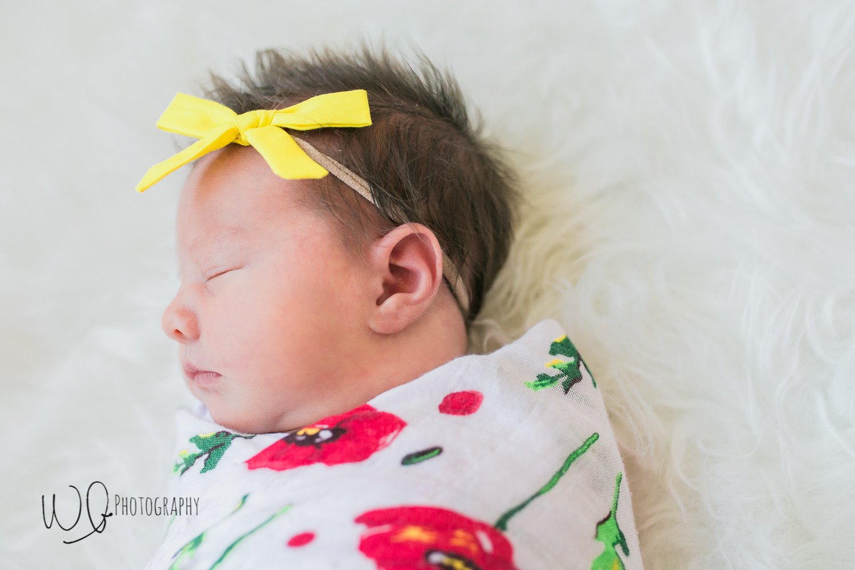 yellow bow on newborn