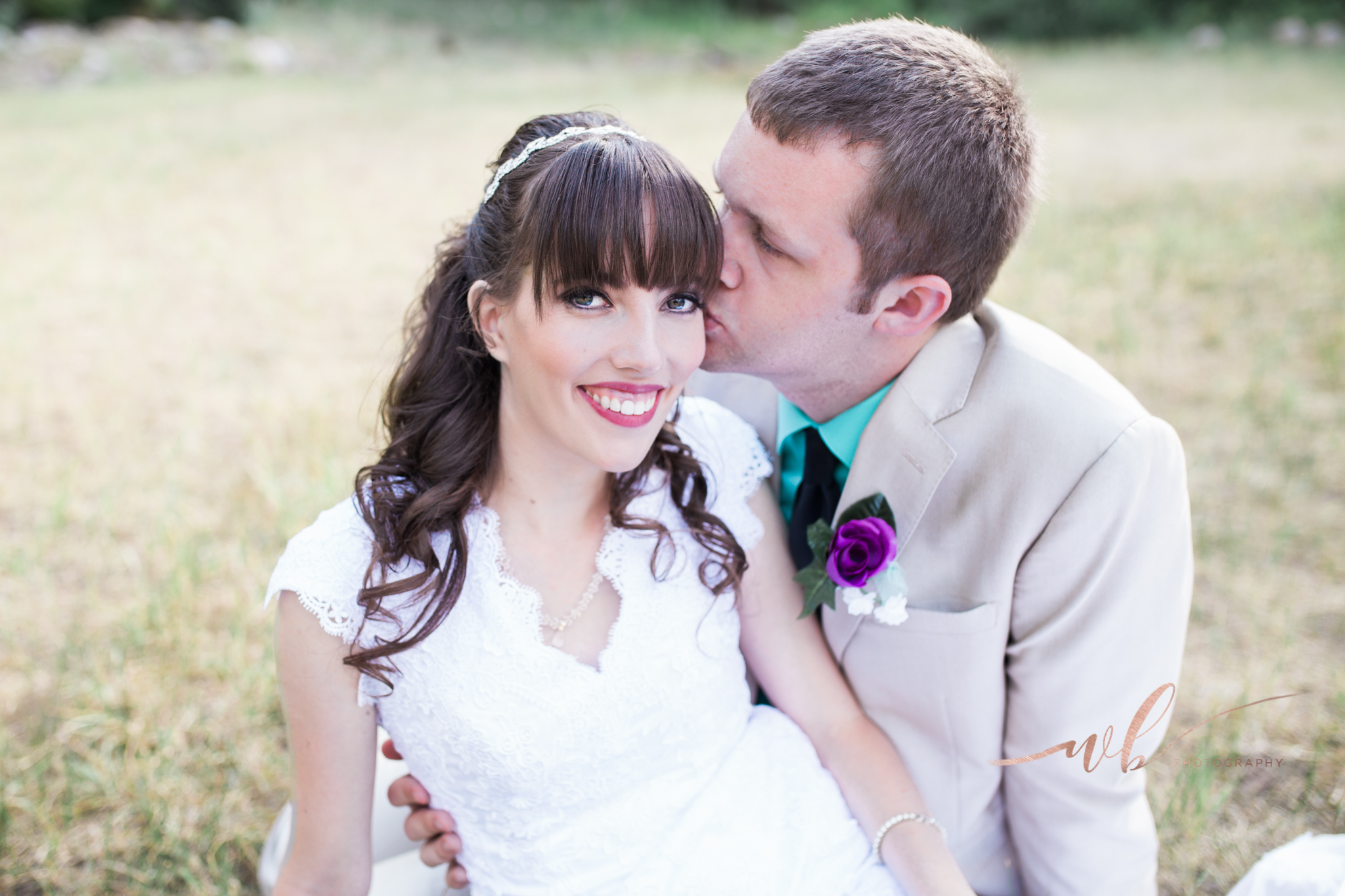 groom kissing bride pictures