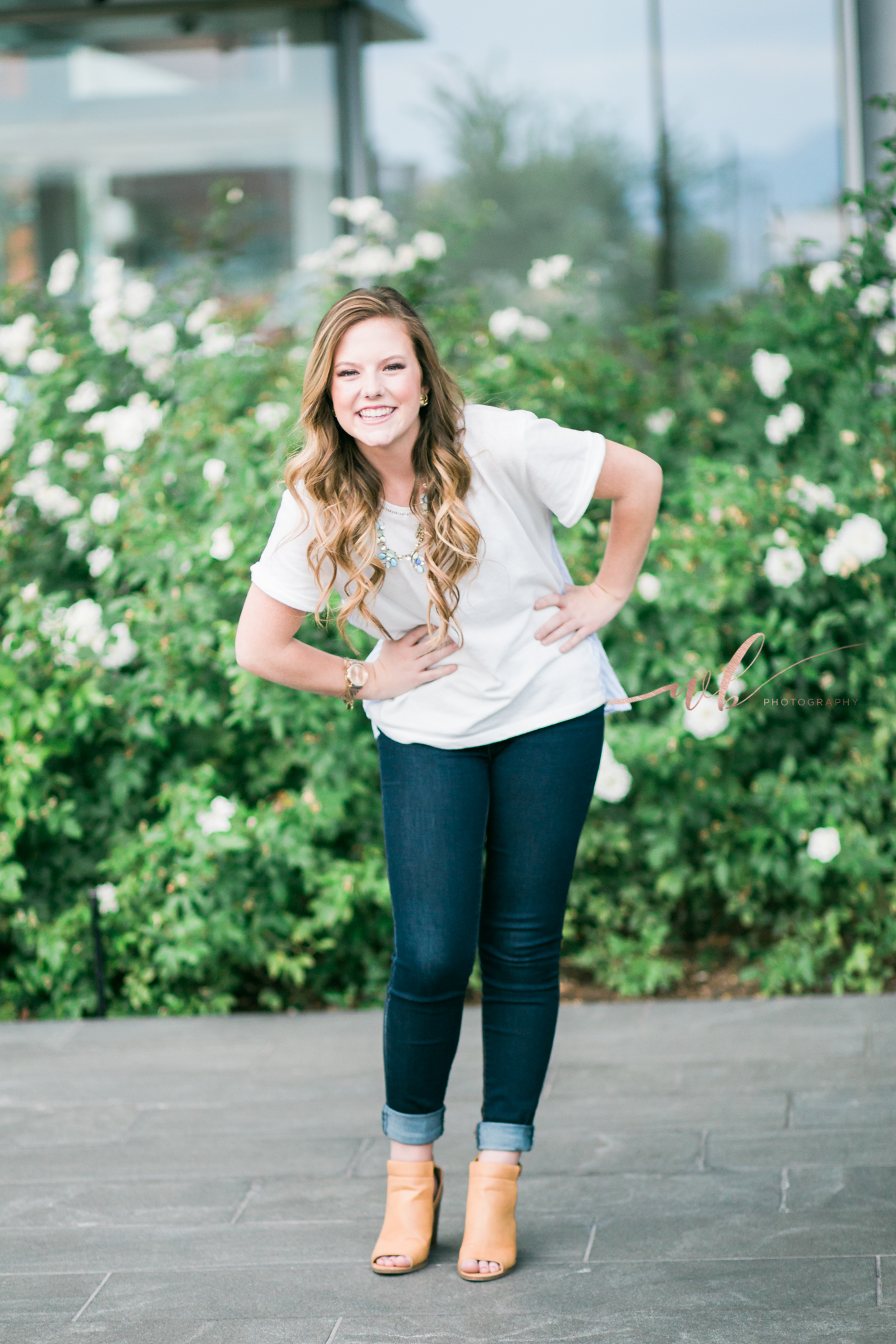 Senior pictures in Rose bushes