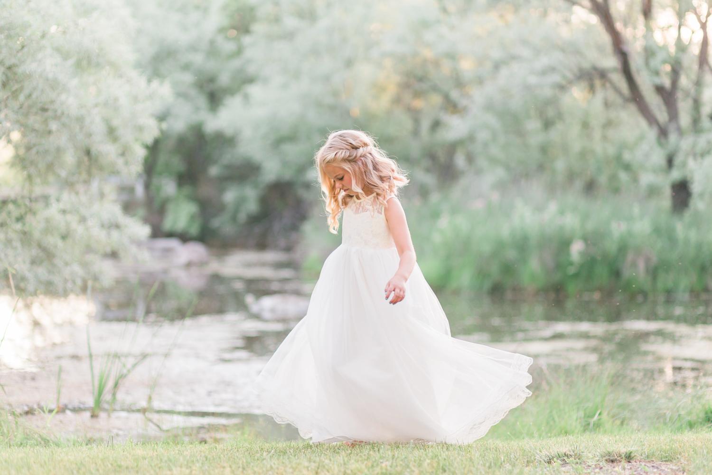 Little girl twirling in dress