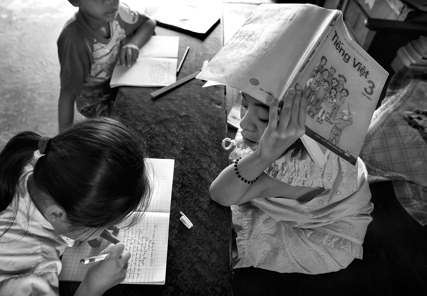 Thao tutoring local children from the village in her library. ~ Stephen Katz
